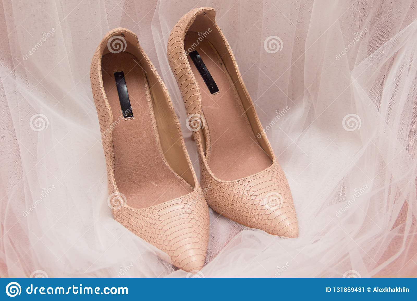 Wedding shoes and white wedding or bridal veil