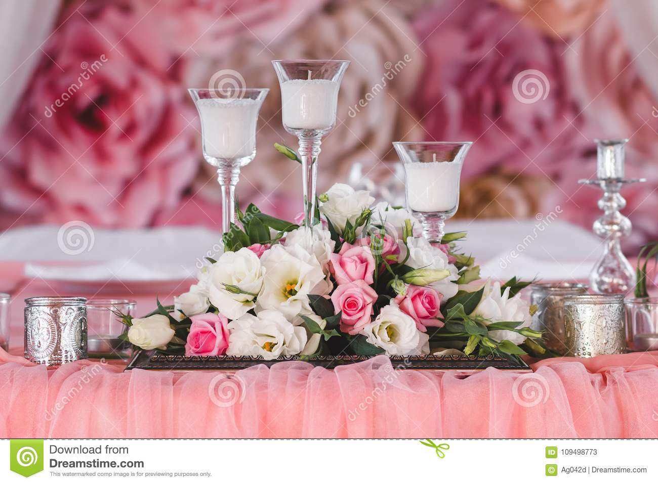Wedding Table Decorated With Fresh Flowers, Candles And Silver Cups ...