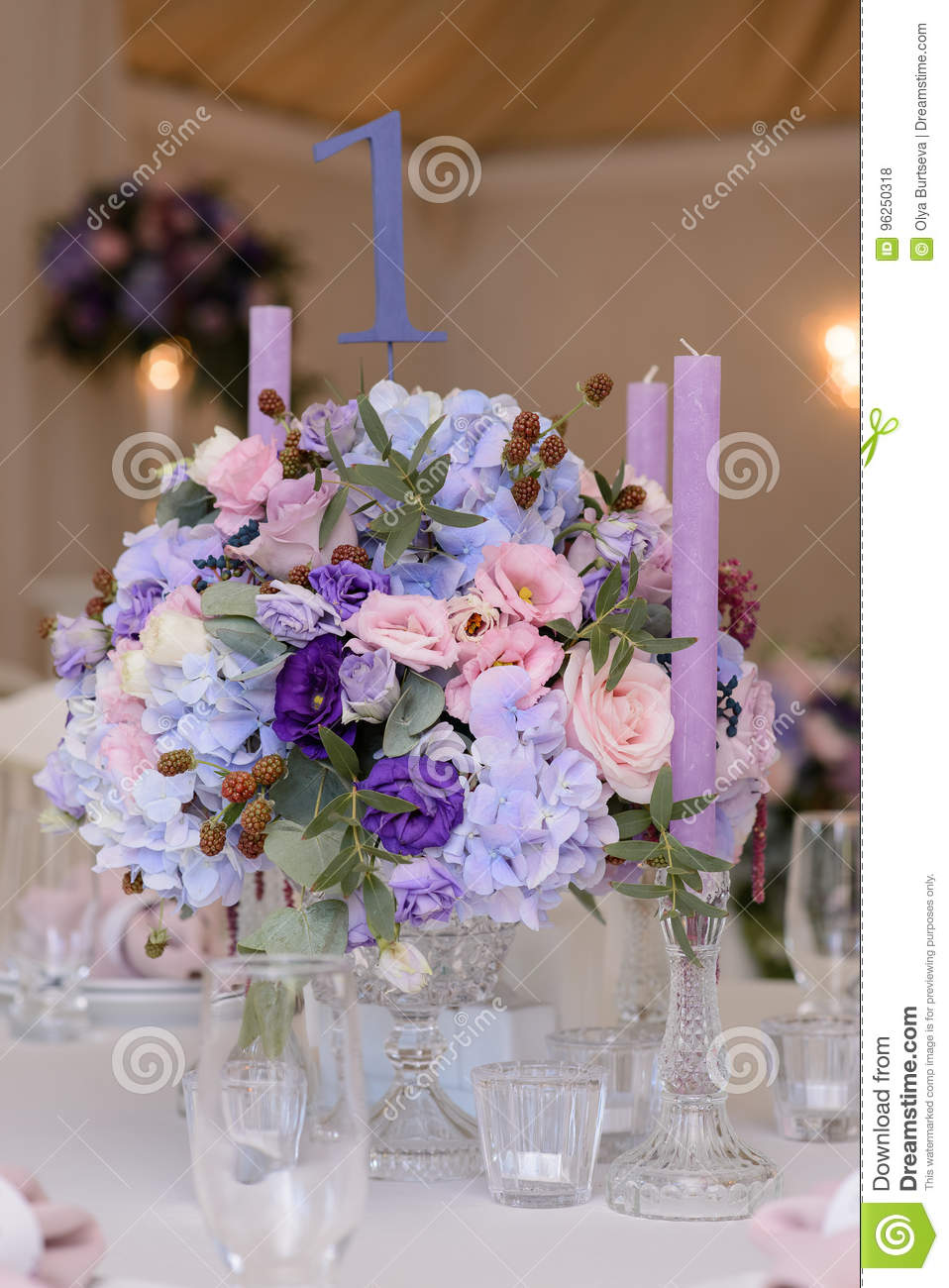 Wedding Table Decoration With Violet Blue Pink Flowers And