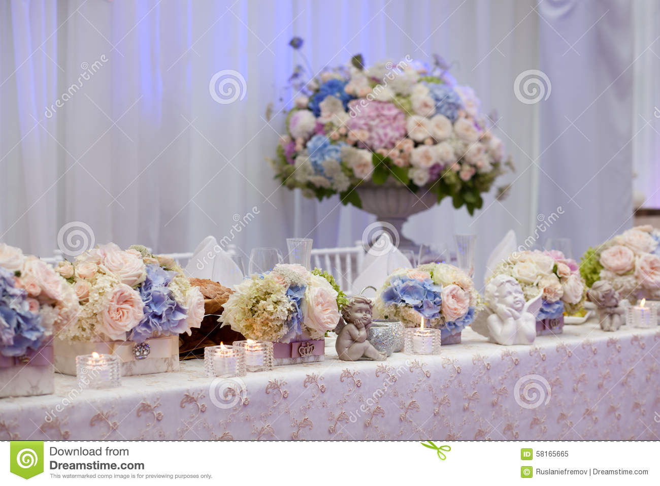 Wedding table setting decorated in the restaurant.