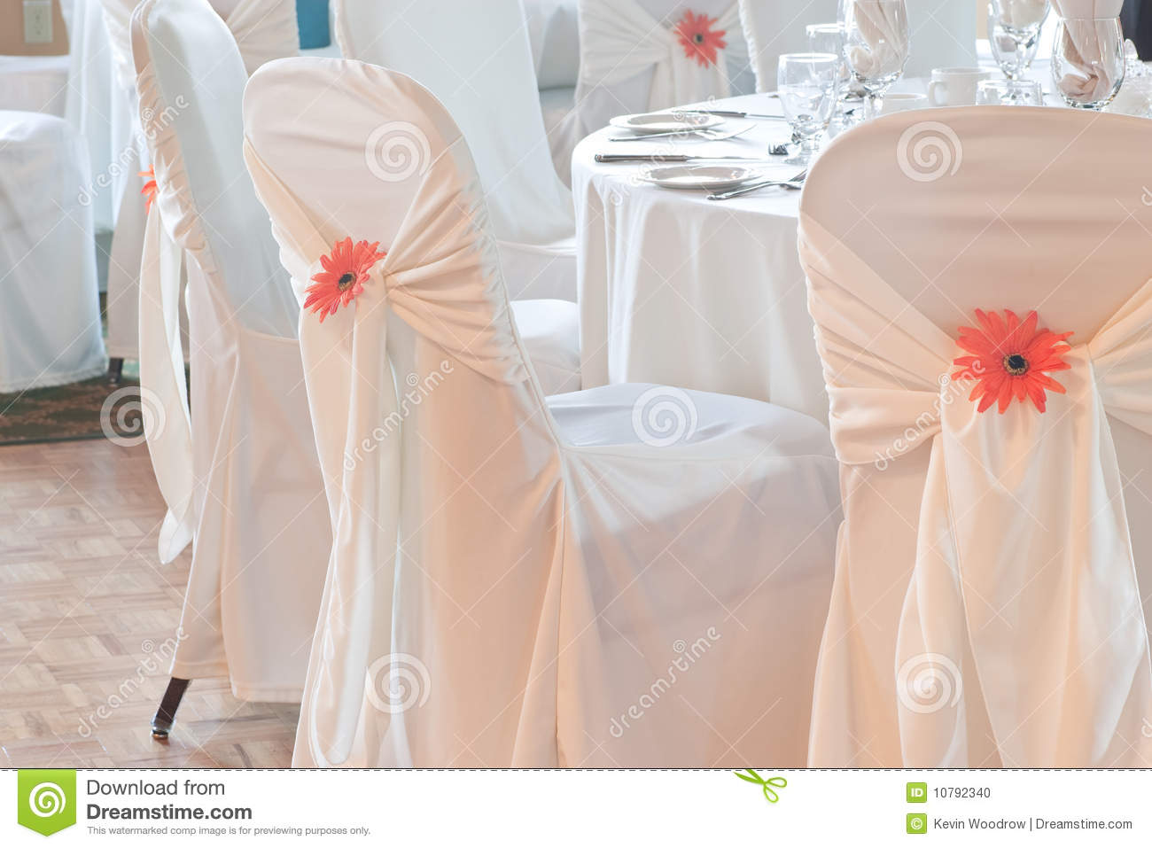 Wedding Table With White Linen And Covered Chairs Stock