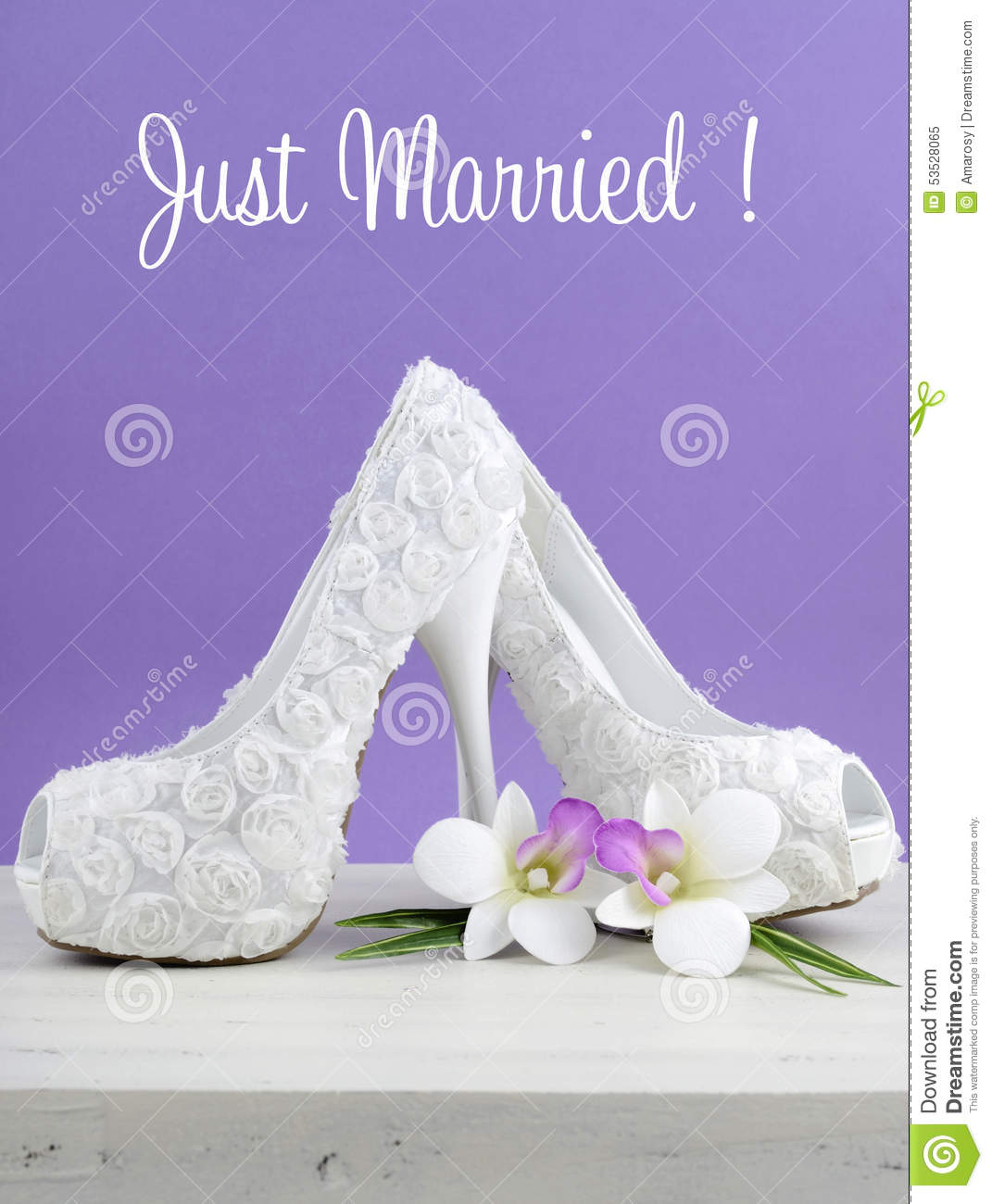 6737c9de634 Wedding theme white floral bridal shoes with flowers on shabby chic white  table and purple background.