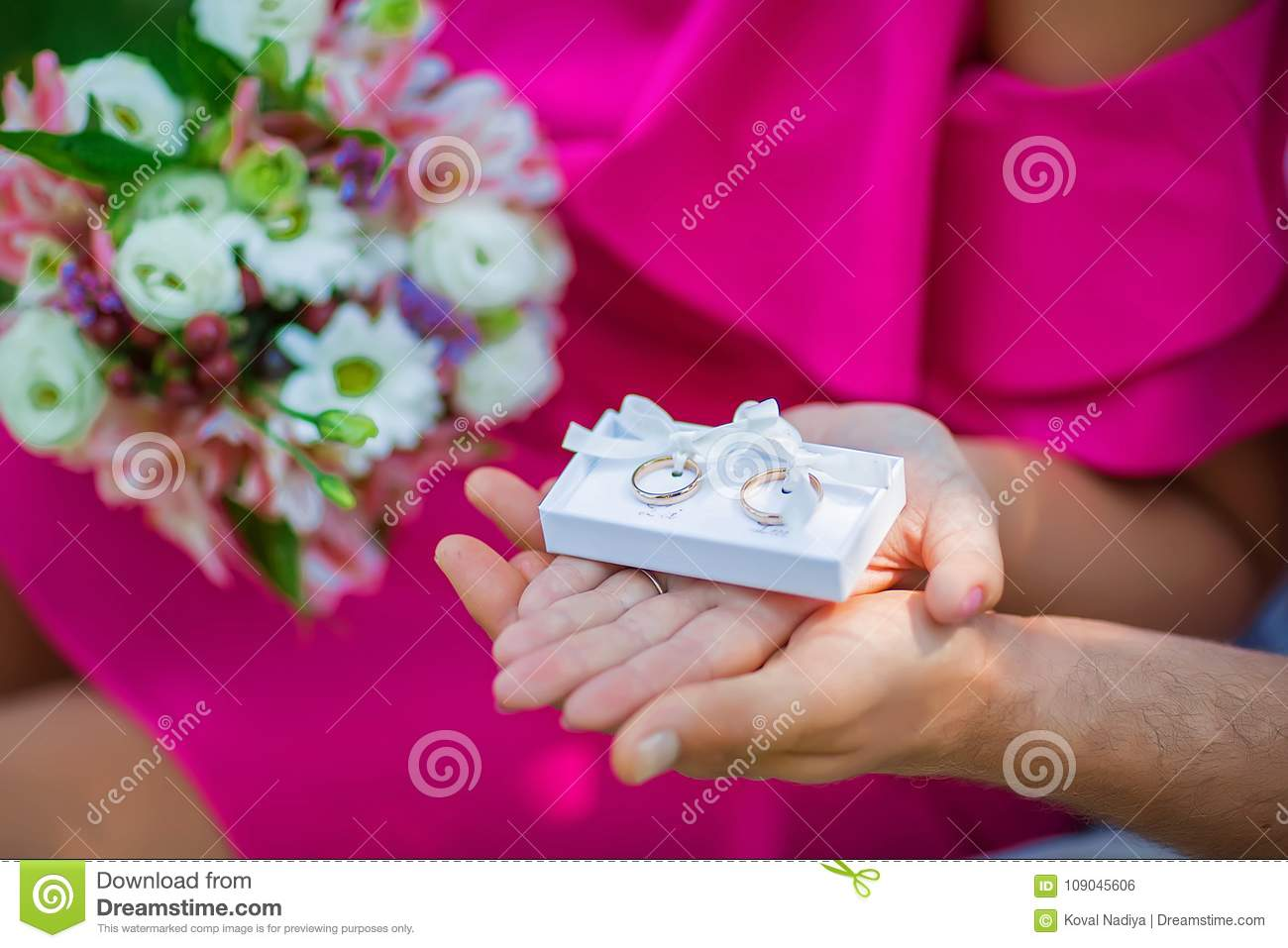Wedding White Box With Gold Wedding Rings In The Hands Of The Brides ...