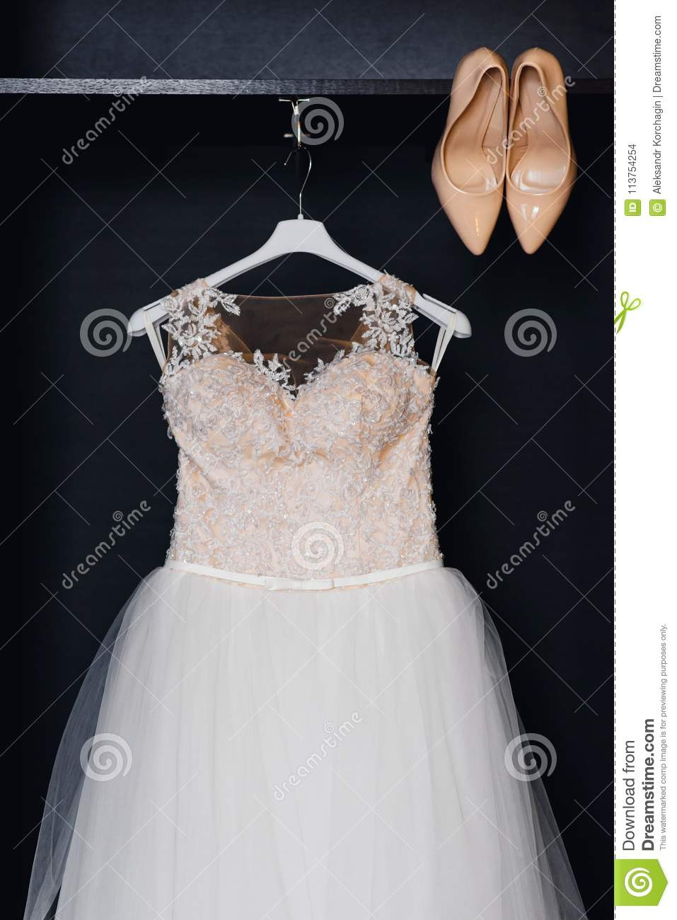 Wedding White Bridesmaid Dress On A Hanger With Corset And Beige