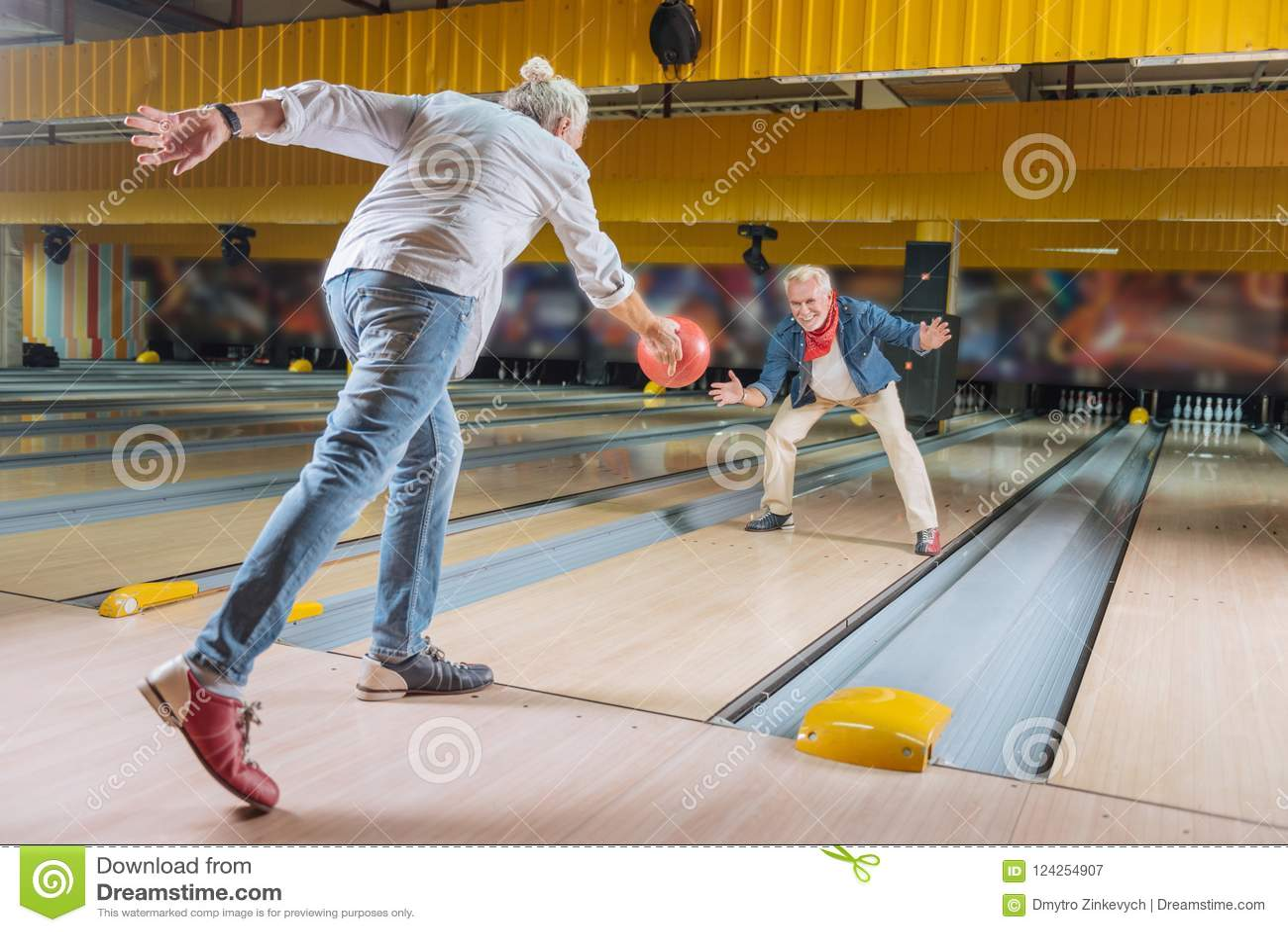 Delighted nice elderly men having fun together