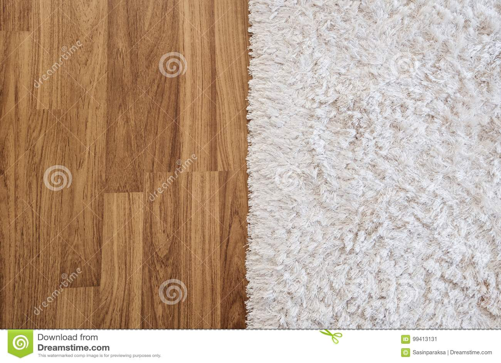 Holzfußboden Für Wohnzimmer ~ Weißer luxusteppich der nahaufnahme auf lamellenförmig angeordnetem