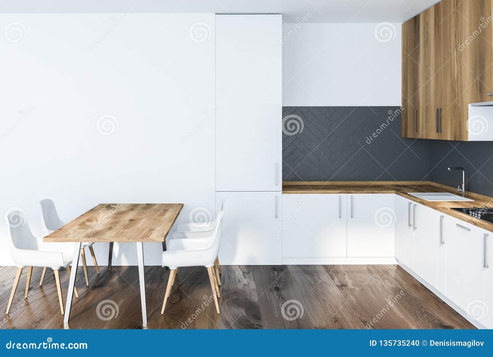 Weißer und grauer Kücheninnenraum mit Tabelle