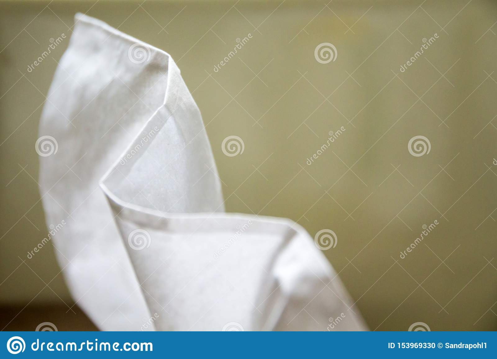 White towelette on green background