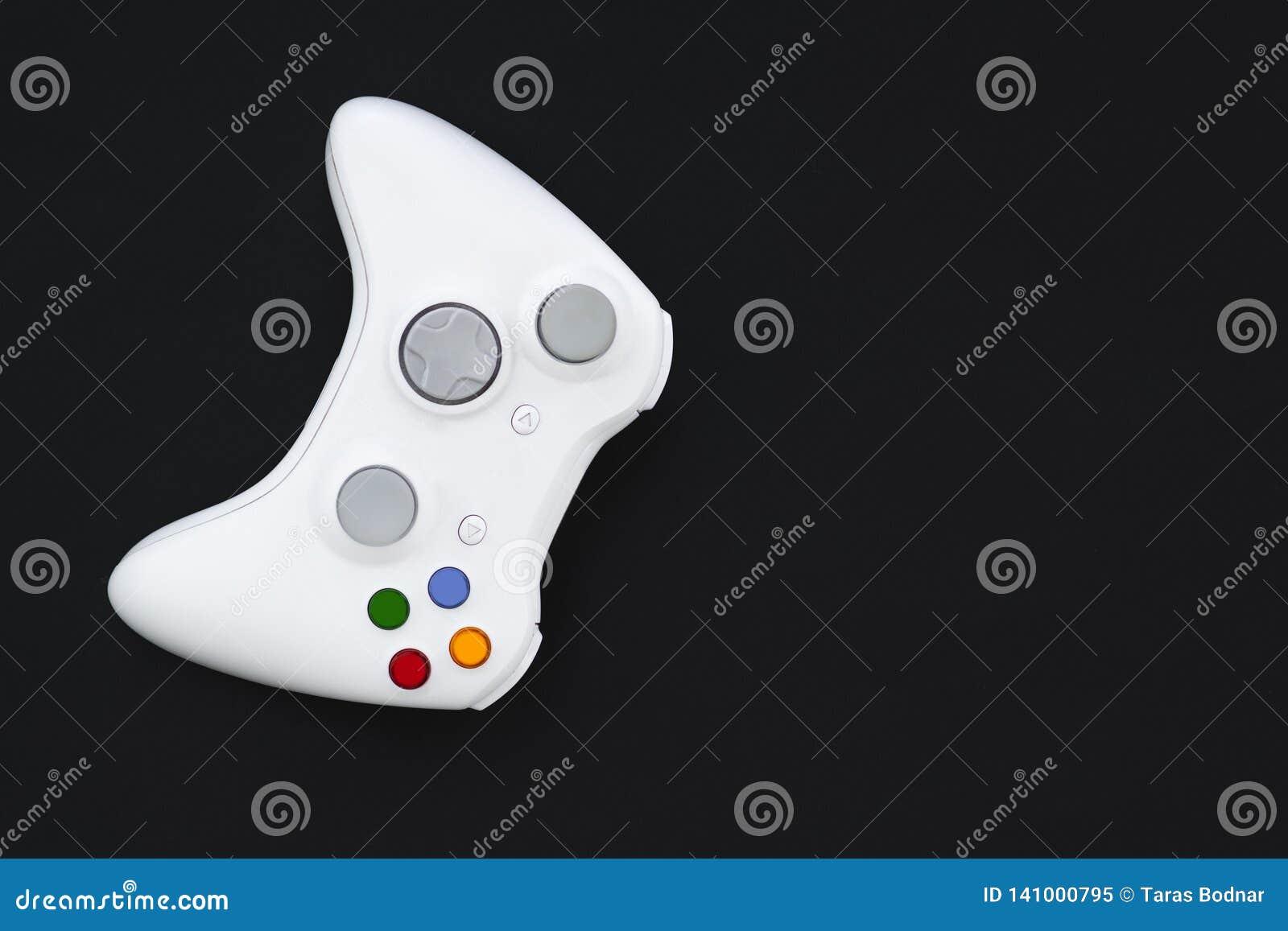 Weißer Steuerknüppel auf schwarzem Hintergrund Das gamepad für die Konsole wird auf einem dunklen Hintergrund lokalisiert