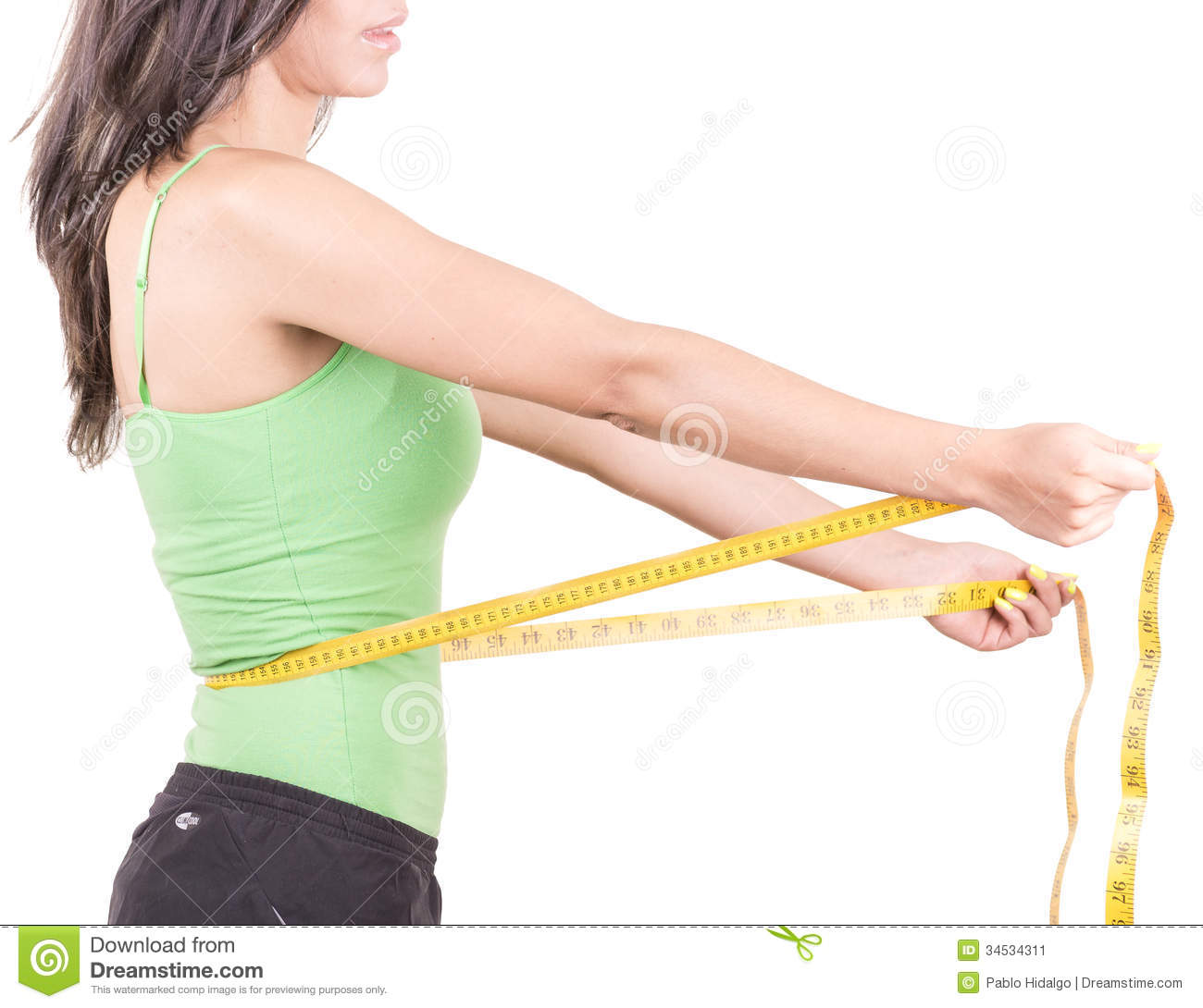weight loss hispanic woman smiling with measuring stock image