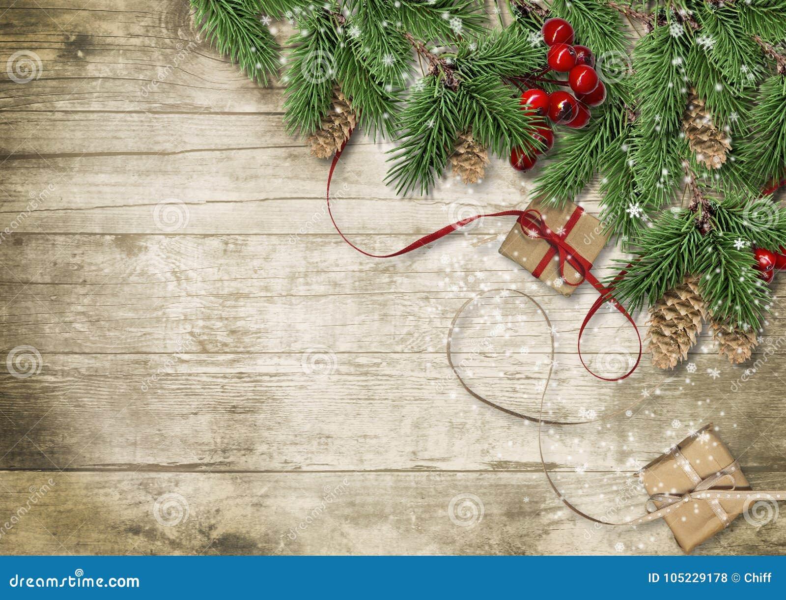 Weihnachtshintergrund mit Baum, Stechpalme und Kegeln glückliches neues Jahr 2007