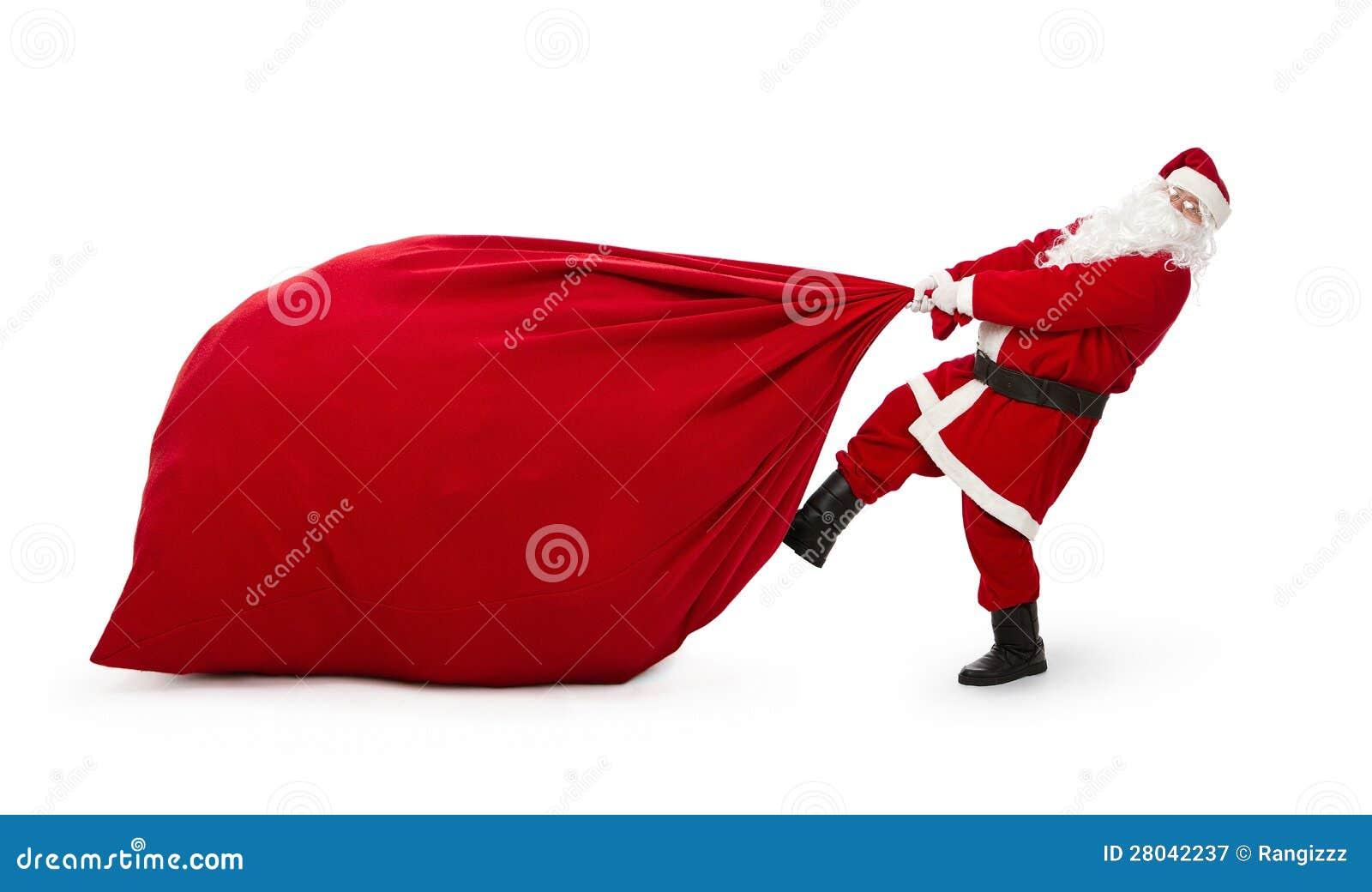 Weihnachtsmann mit enormer Tasche der Geschenke