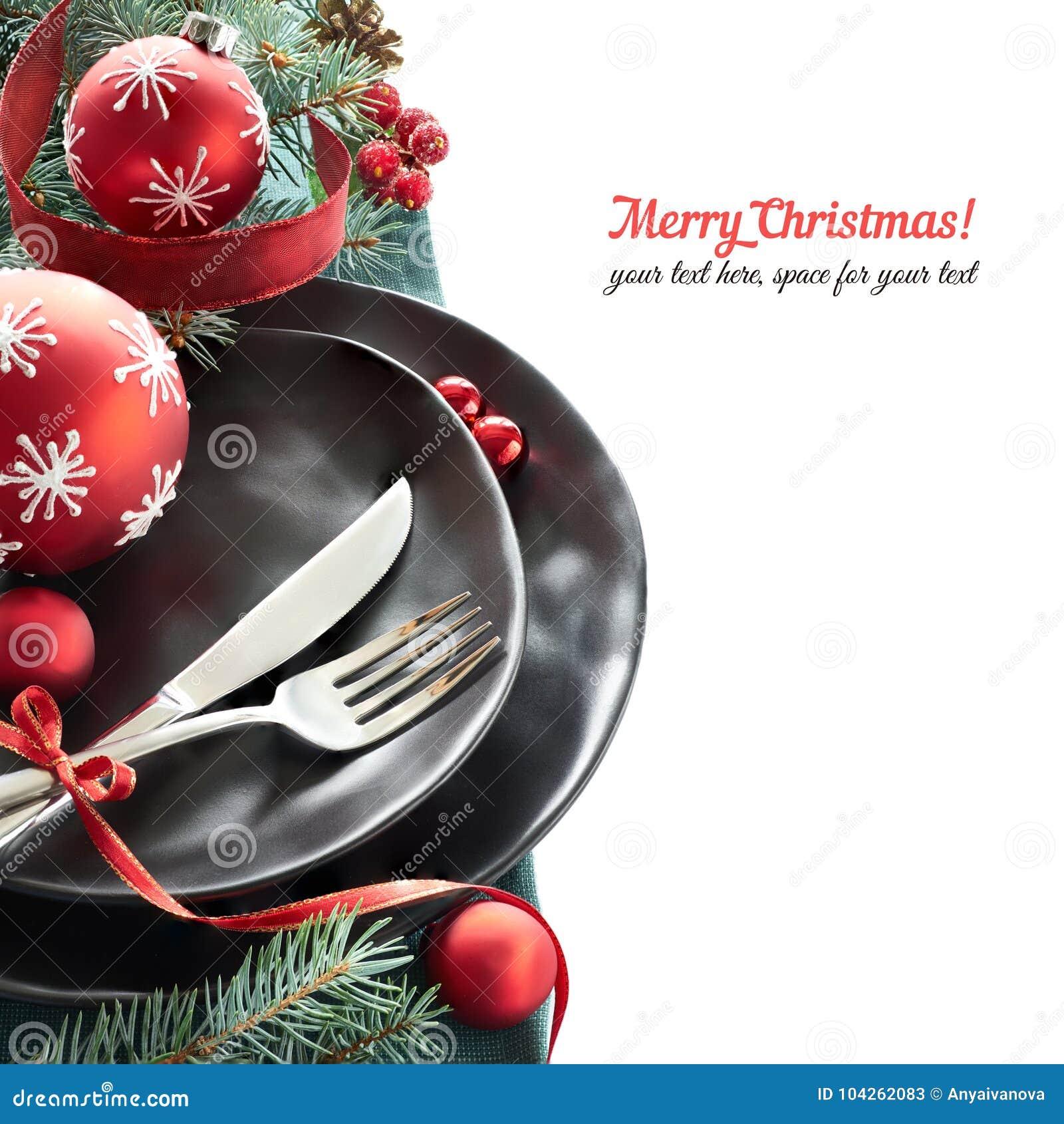 Weihnachtsmenükonzept mit Schwarzblechen und Tischbesteck an