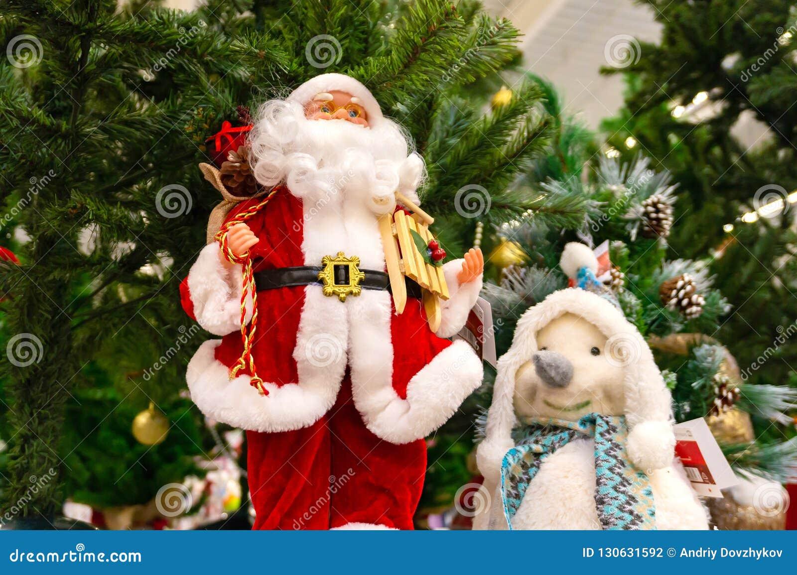 Weihnachtsspielzeug, das Schnee-Mädchen nahe bei Santa Claus