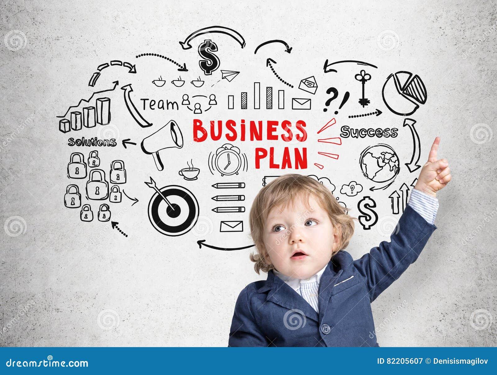 Weinig jongen en een schets van het businessplan op beton