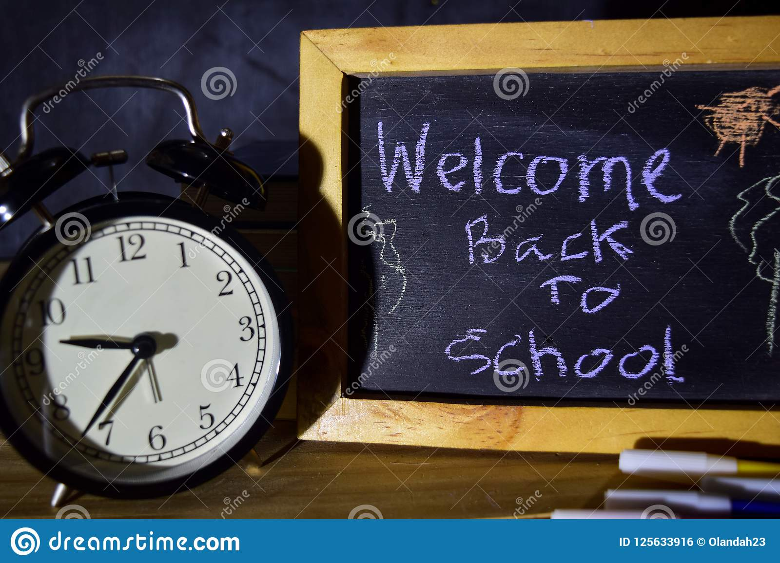 Welcome back to school message concept with quote written on chalkboard.
