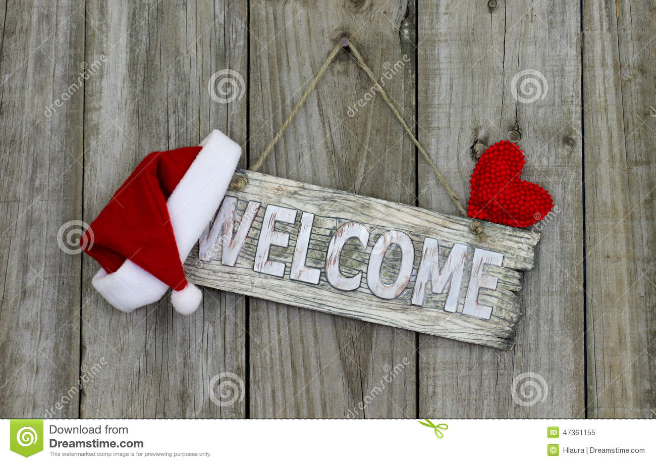 Welcome Sign With Christmas Santa Claus Hat And Red Heart