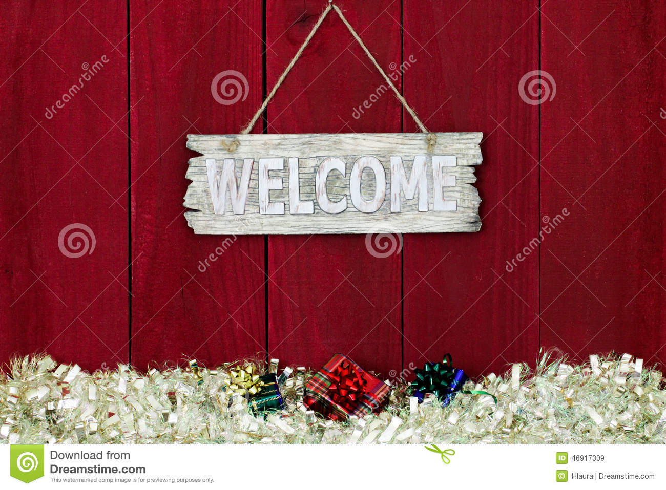 Welcome Sign With Garland Christmas Border Hanging On
