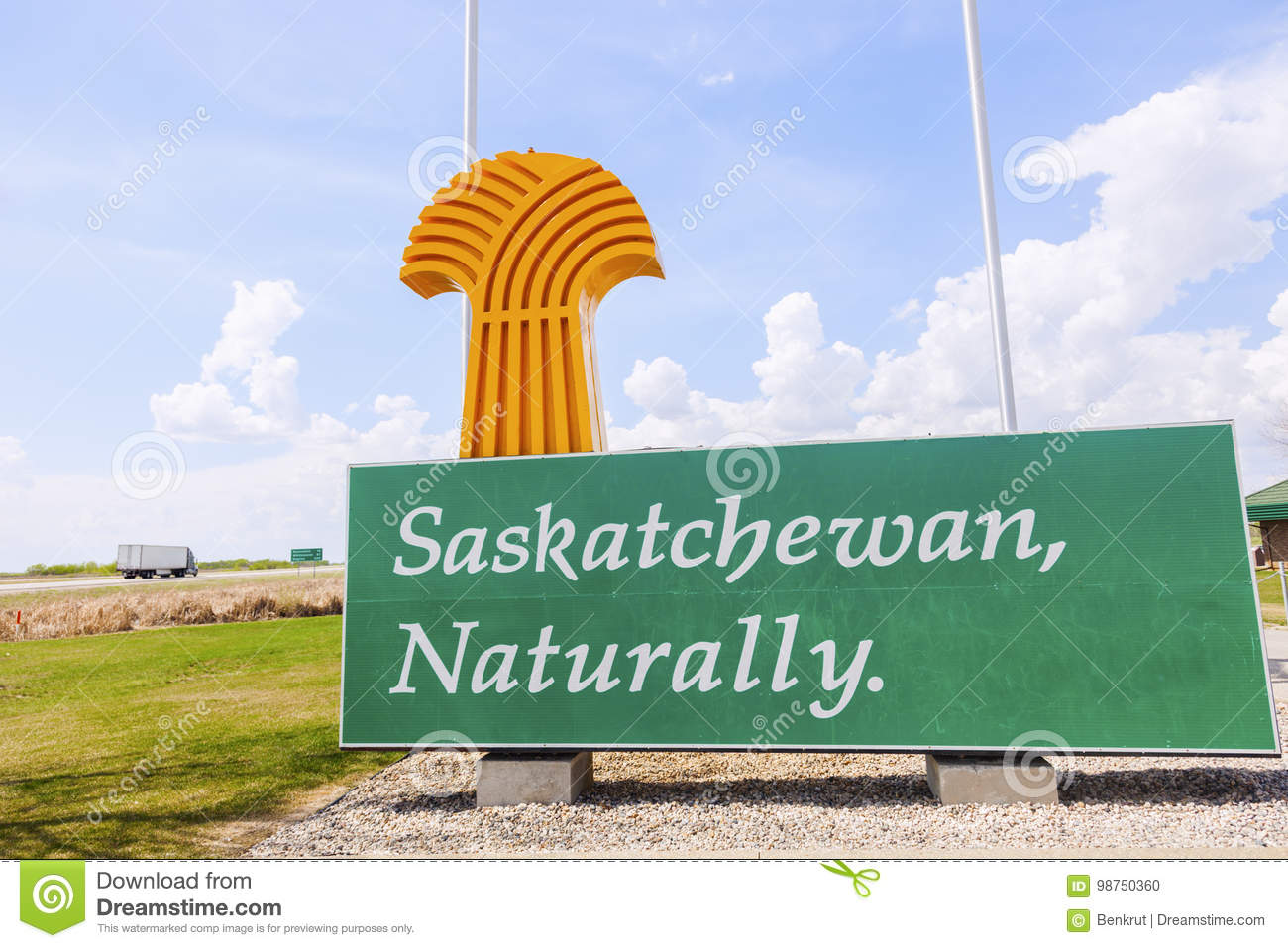 Welcome to Saskatchewan - sign and flags