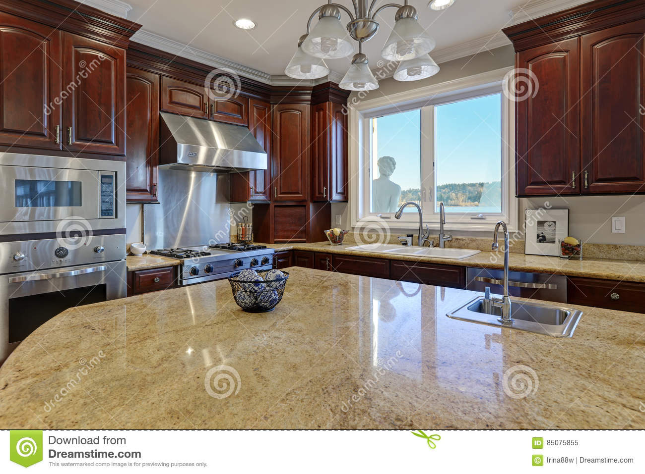 Welcoming Kitchen With Large Kitchen Island In The Center ...