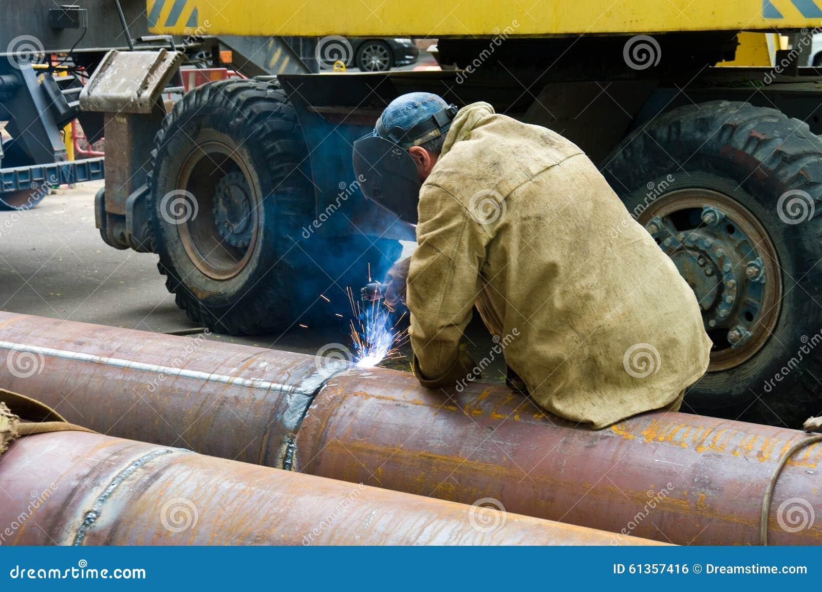 P Pipe Replacement : Welder welds metal construction editorial photo