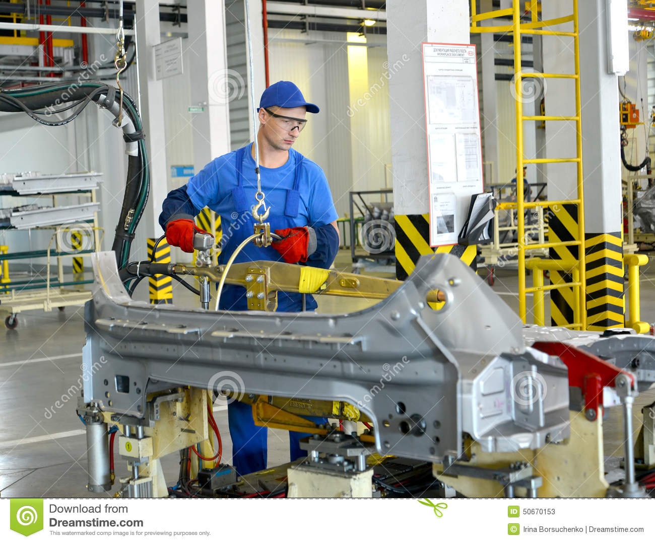 The welder works with the device of spot contact welding. Automobile plant