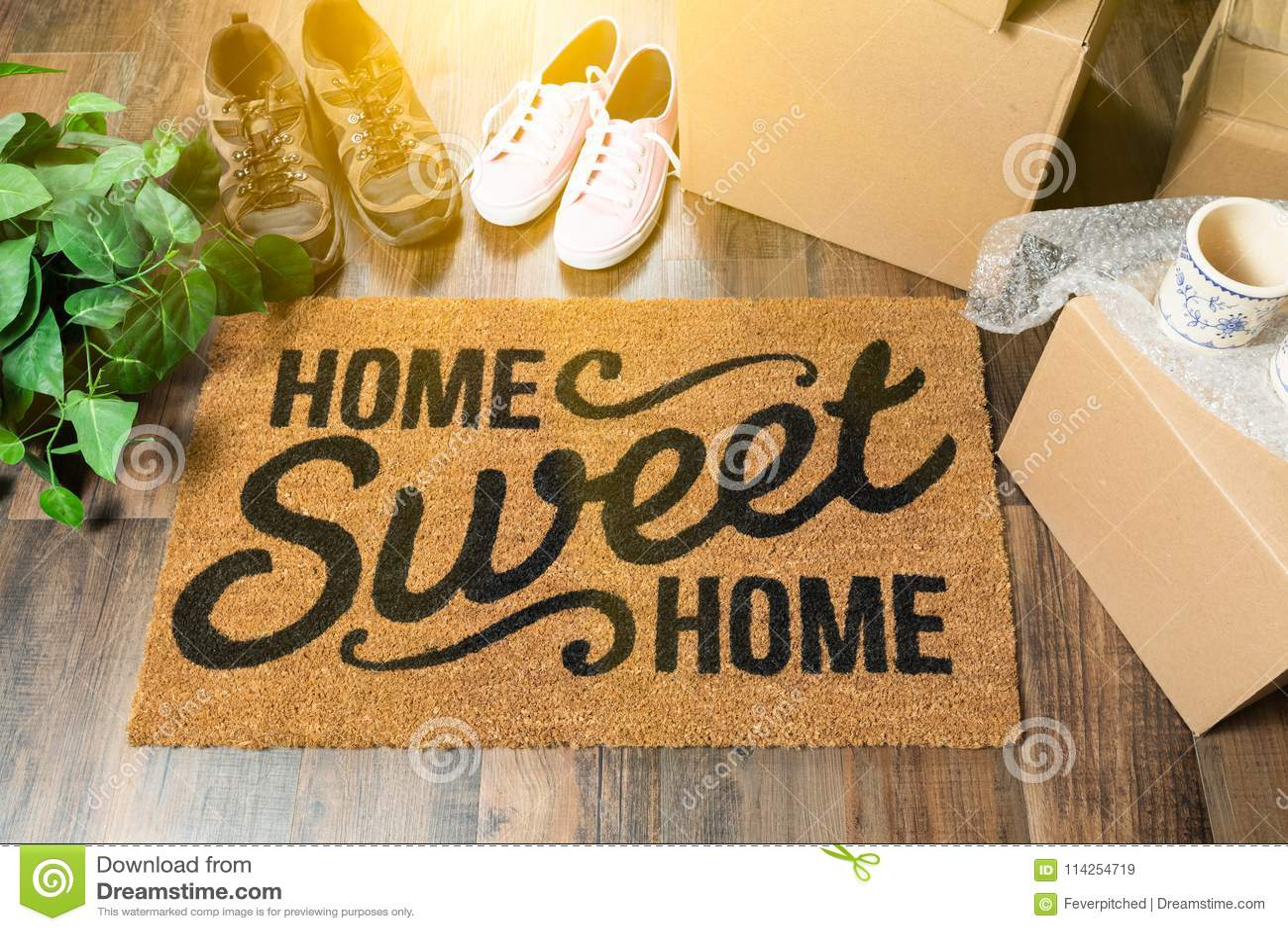 Welkome Mat van het huis de Zoete Huis, Bewegende Dozen, Vrouwen en Mannelijke Schoenen