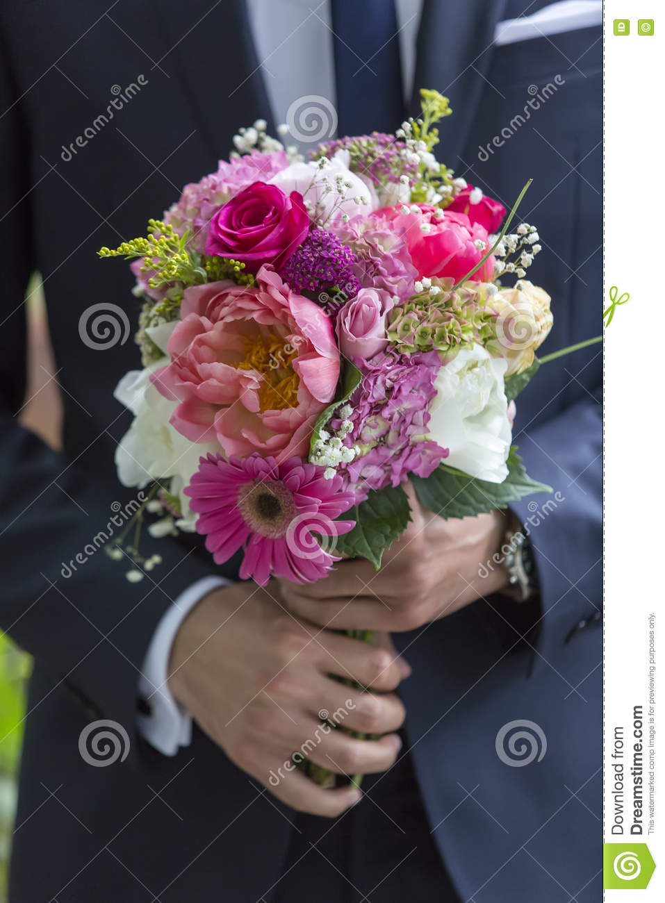 Well dressed man holding a bouquet of flowers holidays and cele download well dressed man holding a bouquet of flowers holidays and cele stock photo izmirmasajfo