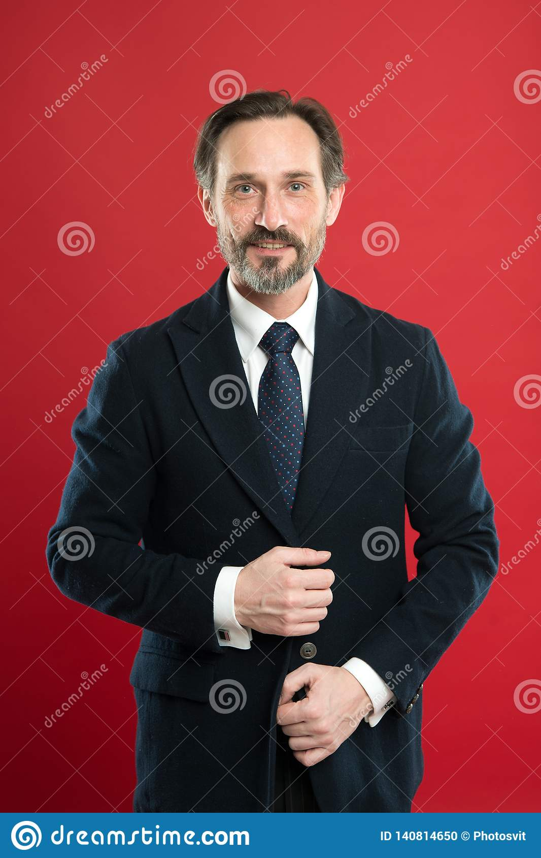 Well groomed. Hair grooming tips. Business man well groomed guy red background. Business people hairstyle. Stylish and