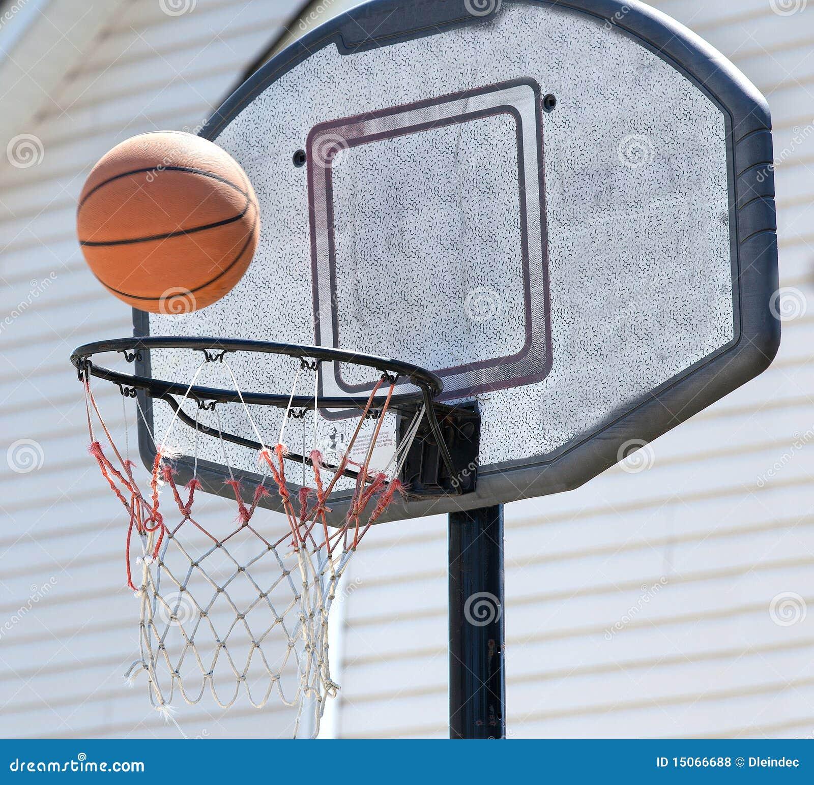 well used backyard backetball hoop and ball royalty free stock