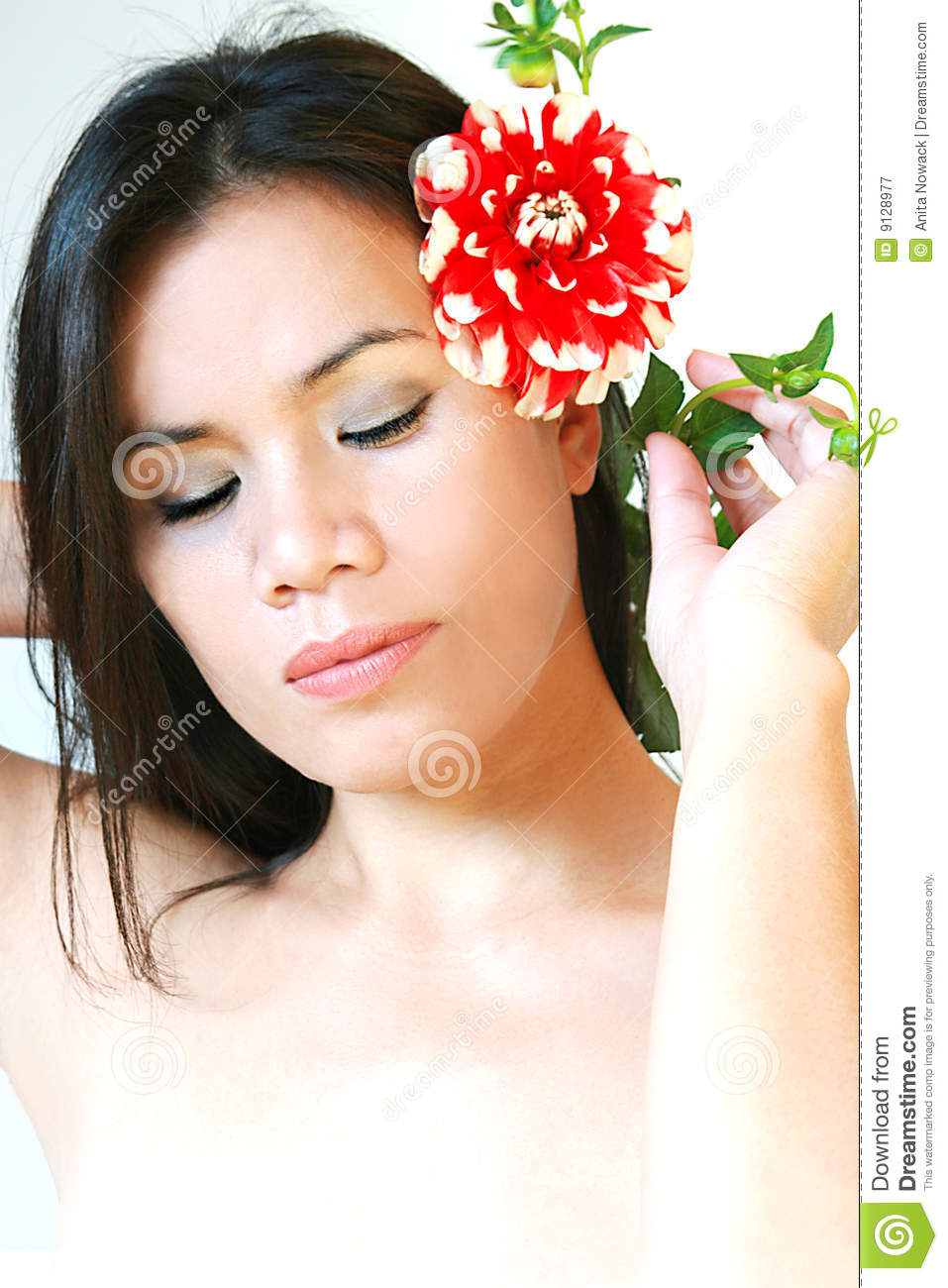 Wellness girl with red flower