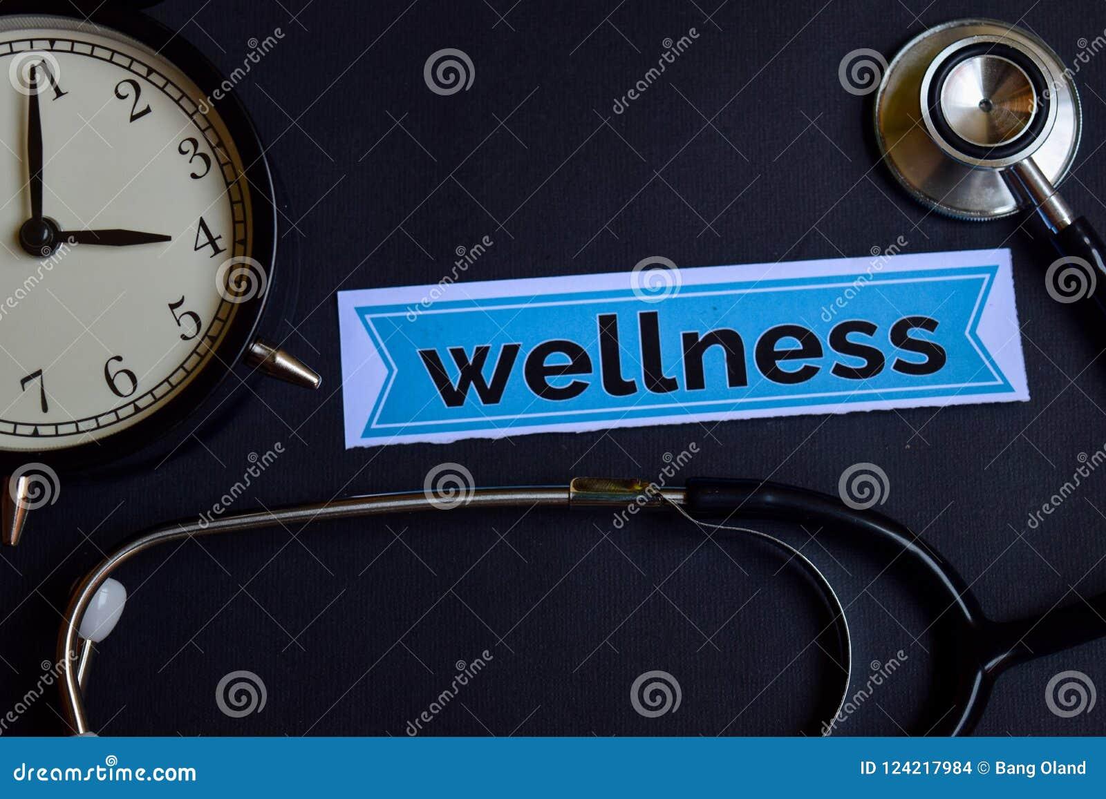 Wellness op het drukdocument met de Inspiratie van het Gezondheidszorgconcept wekker, Zwarte stethoscoop
