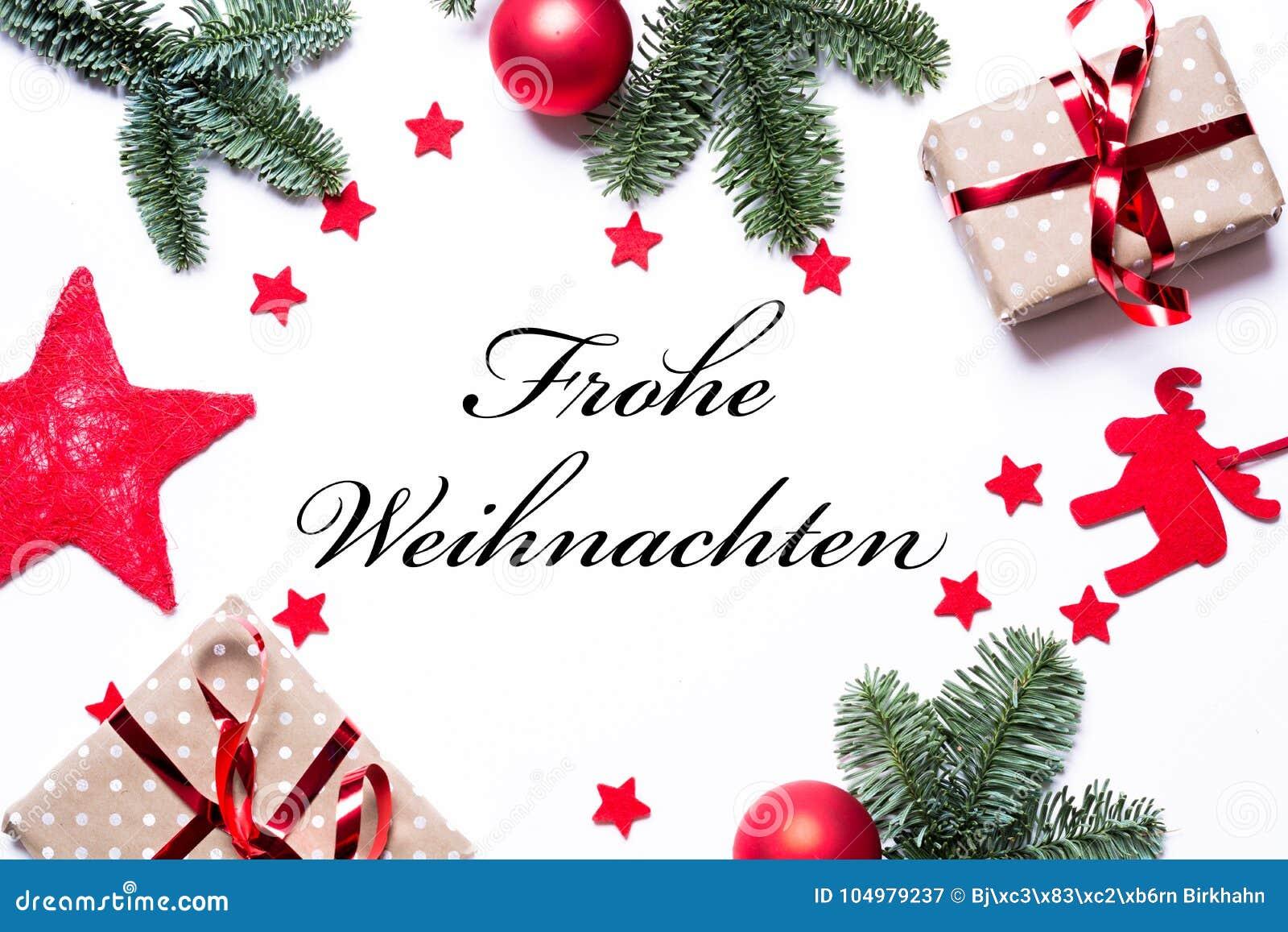Wesoło boże narodzenia w niemiec na Bożenarodzeniowym tle z teraźniejszością