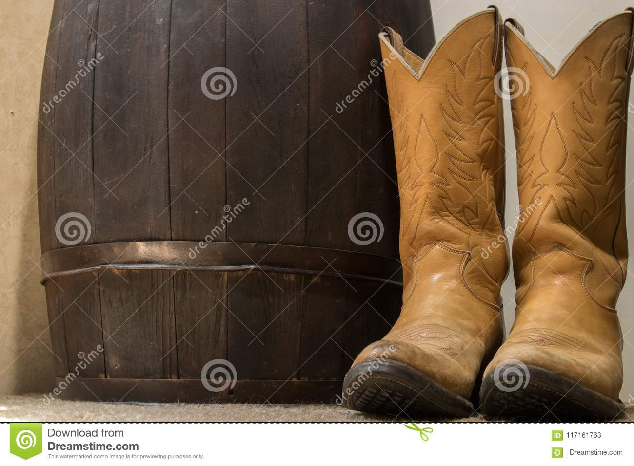 Western Boots Next To Wood Barrel Stock Image - Image of