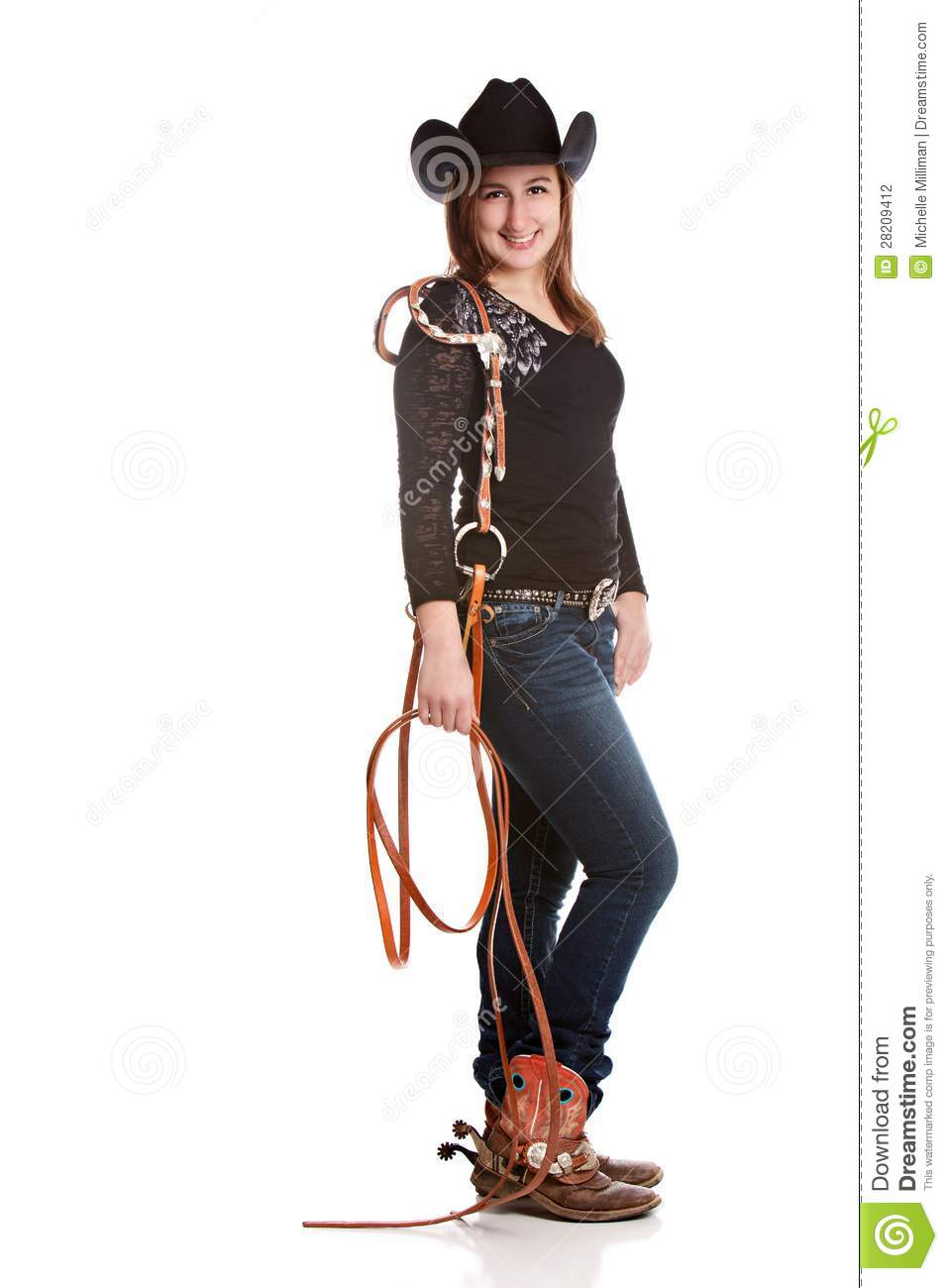 Attractive young woman wearing a Cowboy hat and boots with spurs and ...