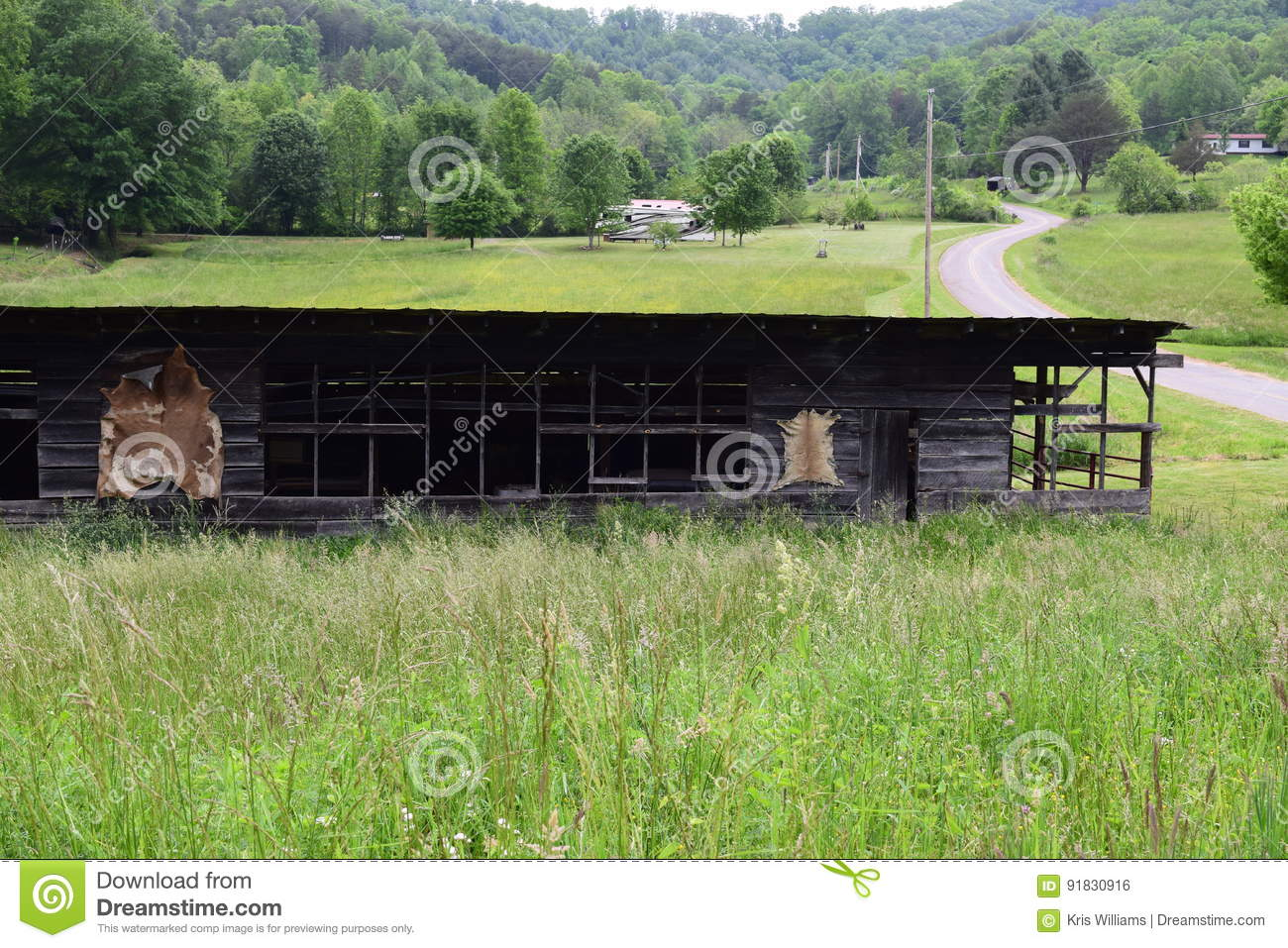 Western NC mountain rural fam barn with winding road