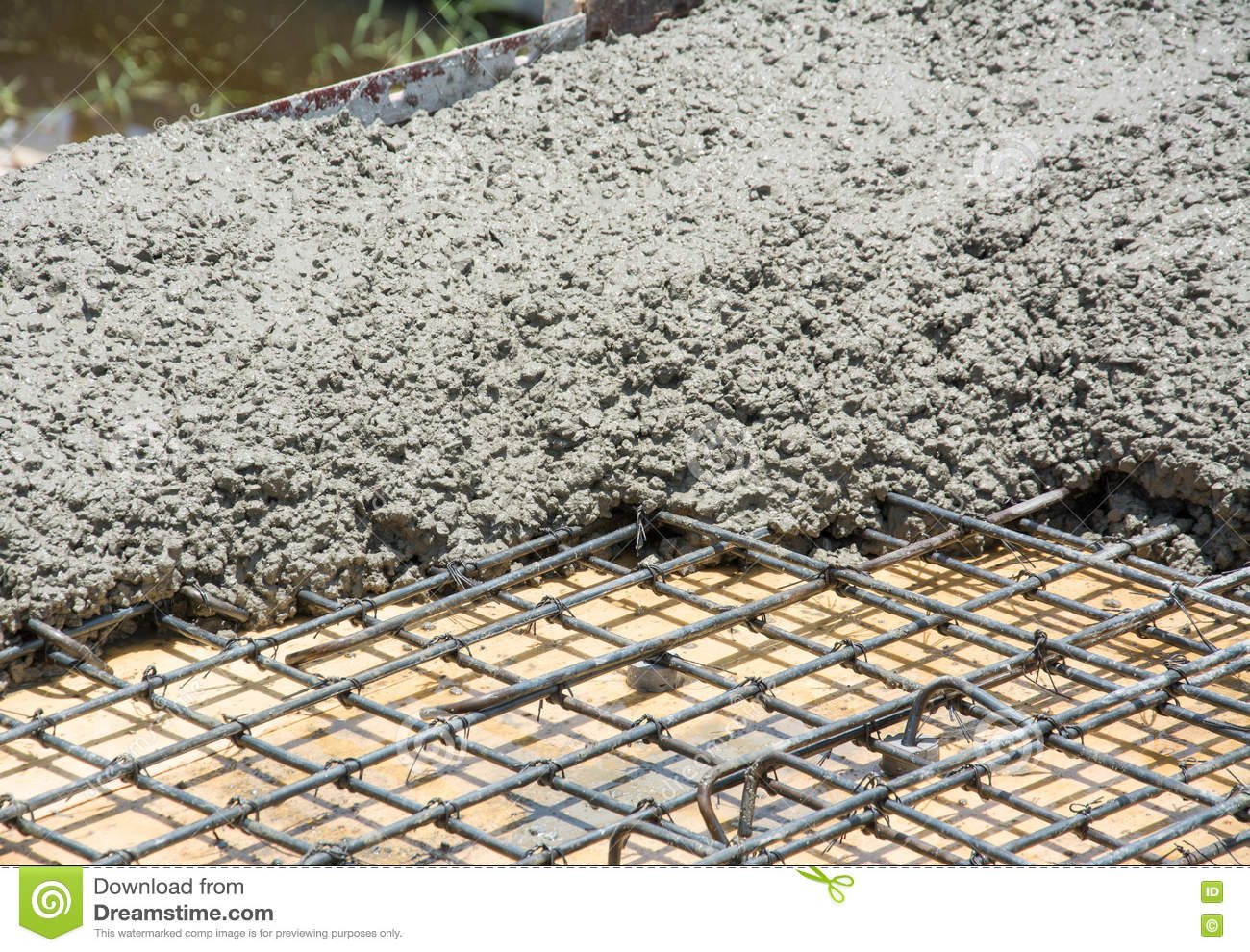 The Wet Concrete Is Poured On Wire Mesh Steel Reinforcement Stock ...