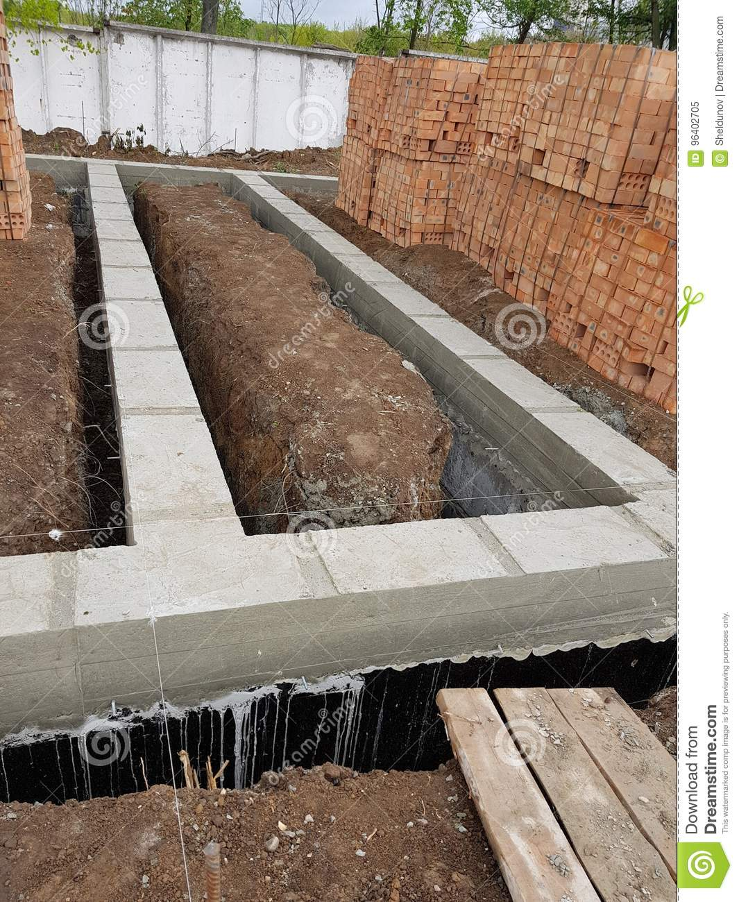 Wet Concrete Is Poured On Wire Mesh Steel Reinforcement