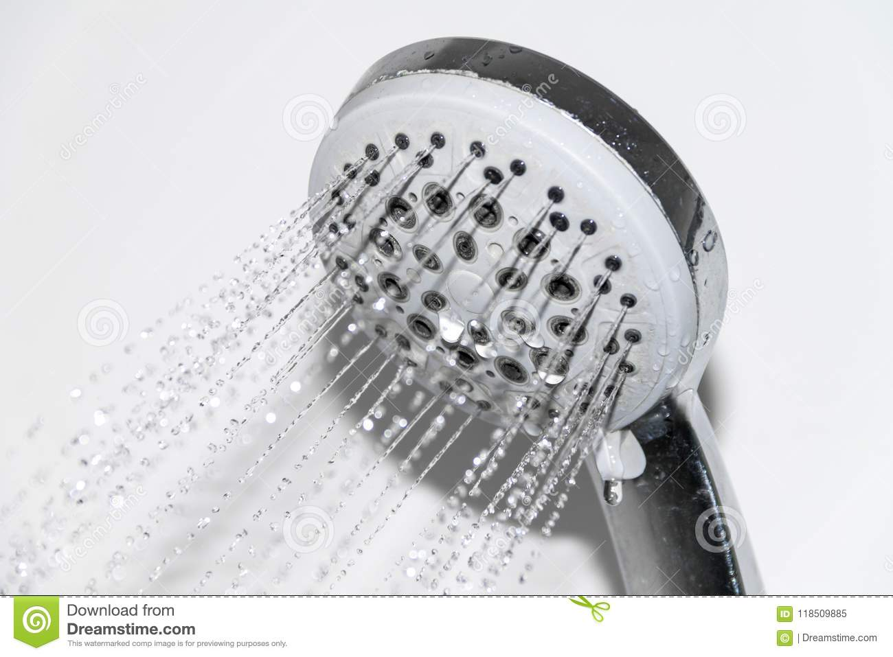 Wet faucet in the shower, water flows from the shower