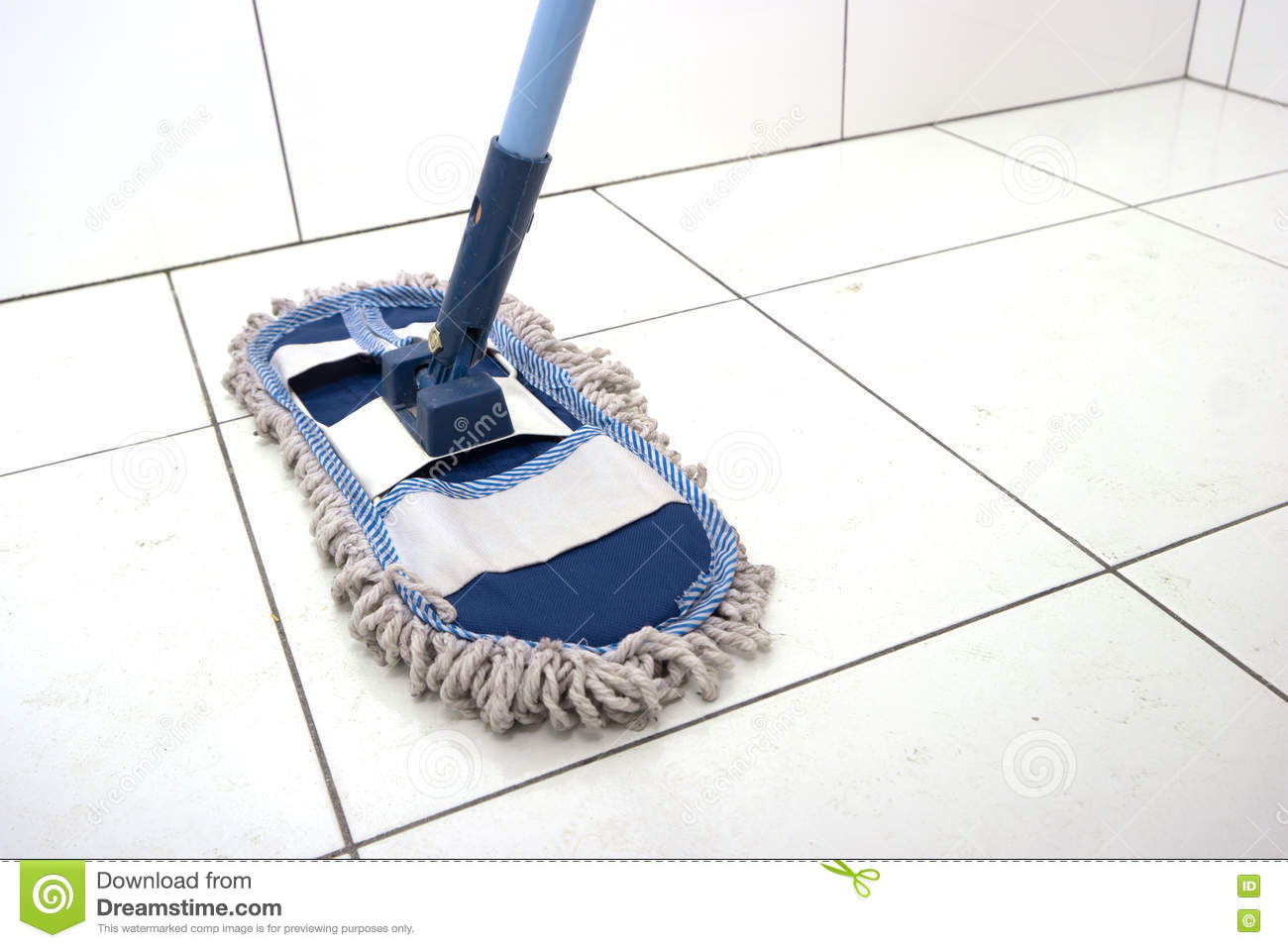 Wet mop on a white tile. stock image. Image of barefoot - 77120751