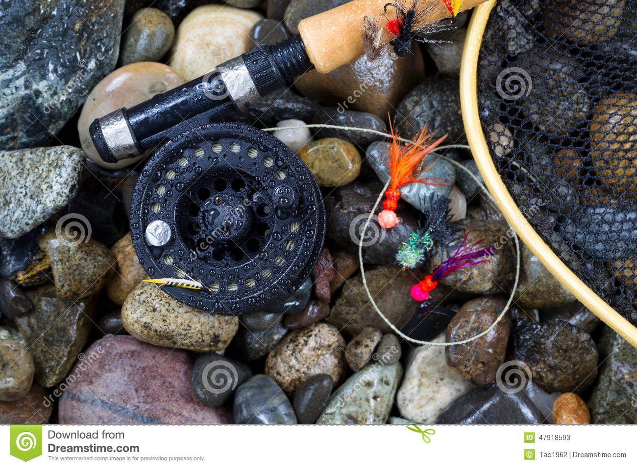 Wet trout fishing gear on river rocks stock photo image for How to get free fishing gear