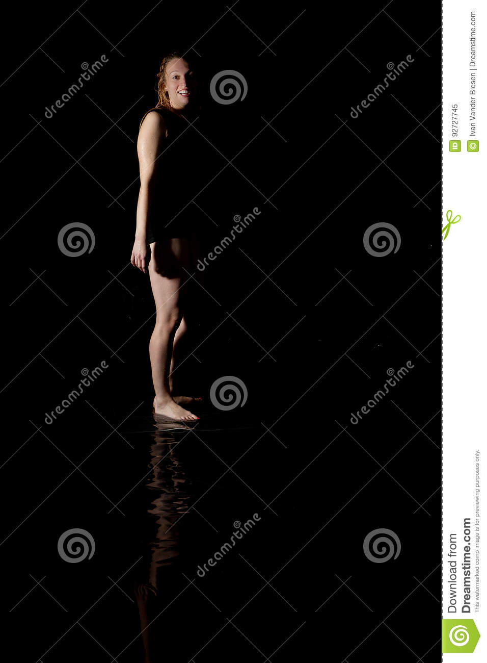 Wet woman black background