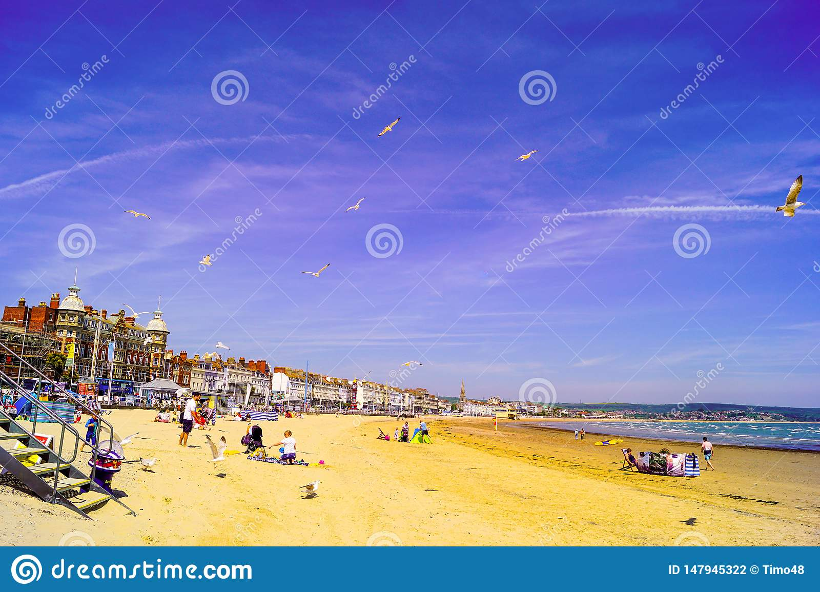 Weymouth beach busy with families enjoying thier holiday