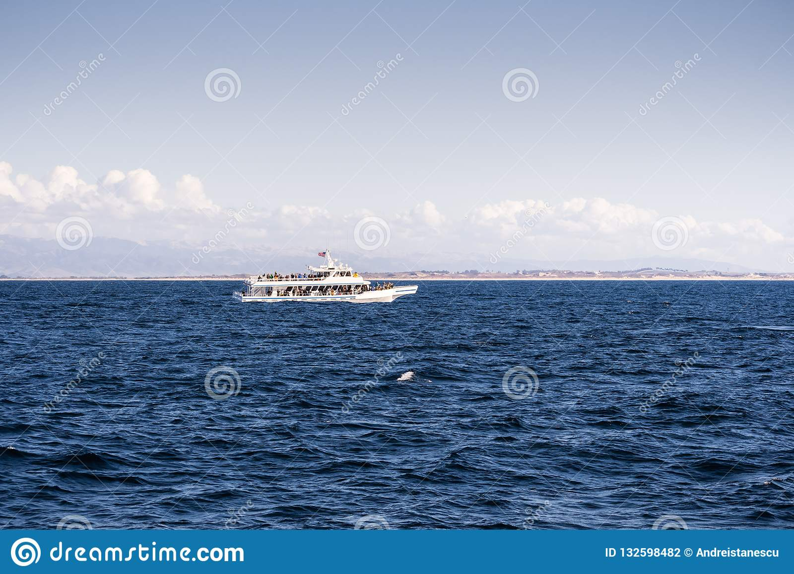 Whale watching cruise ship in Monterey bay, Pacific Ocean coast
