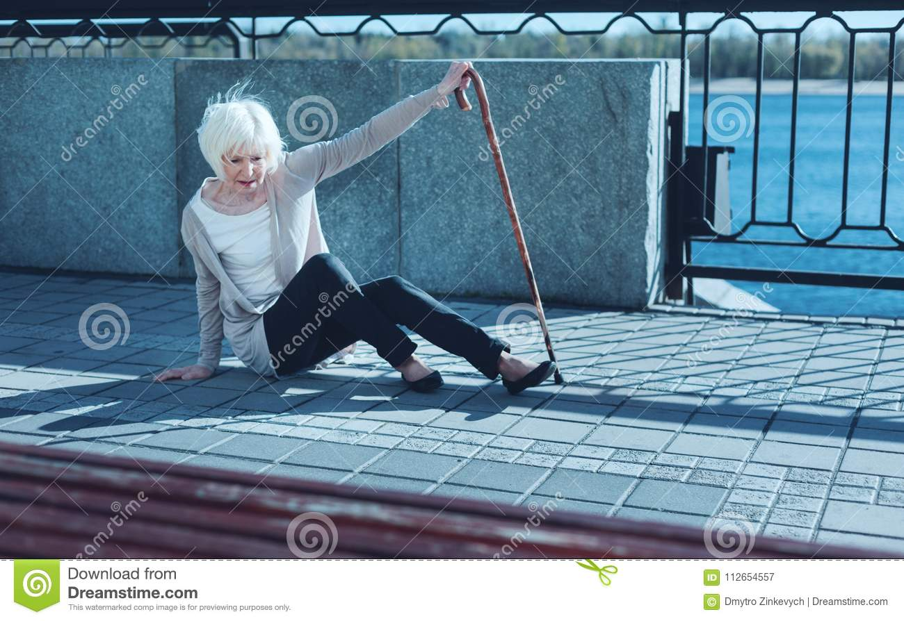 Helpless older lady suffering from dizziness