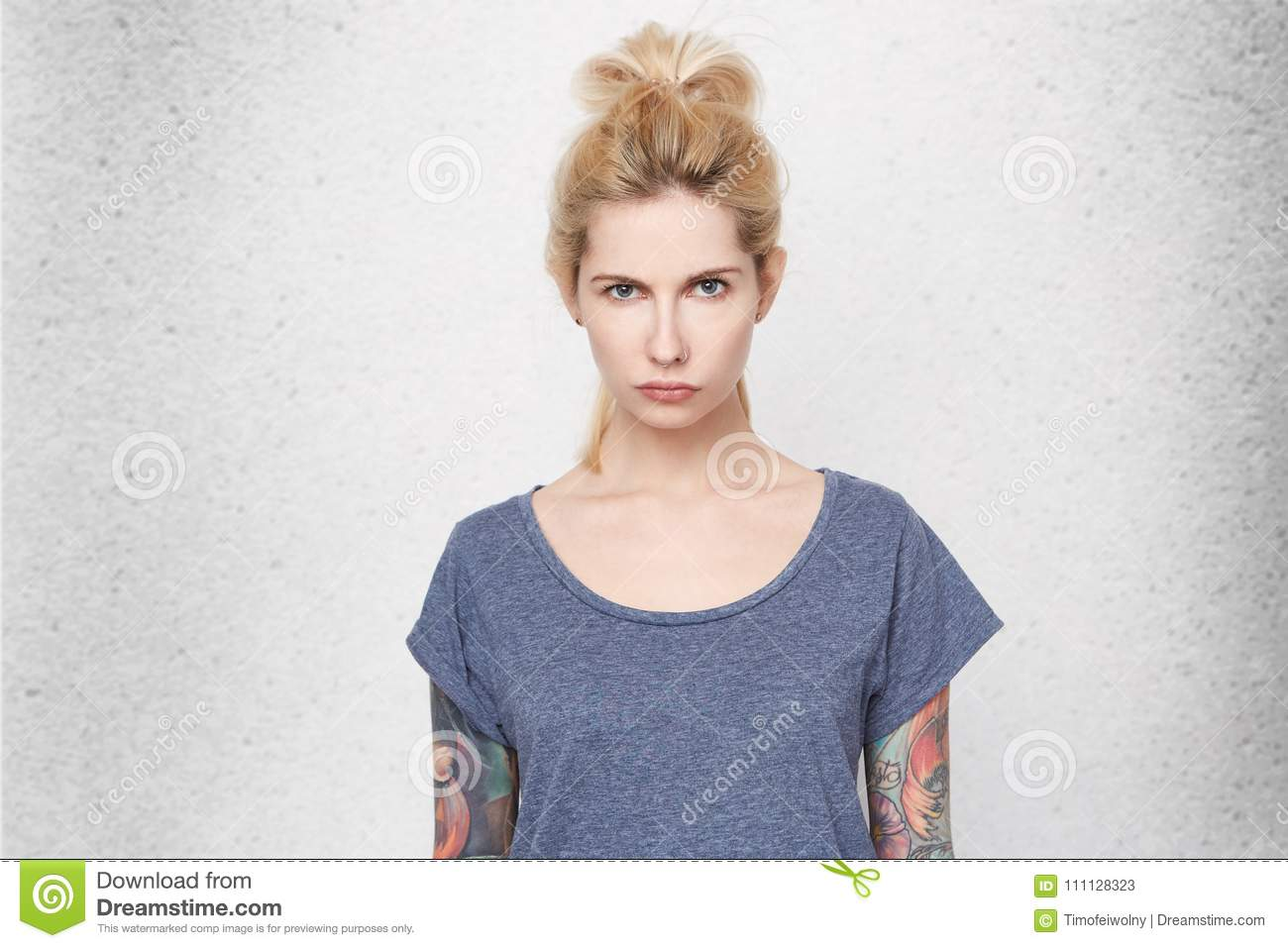 Whats Going On Confused And Surprised Girl With Tattoos Over Her