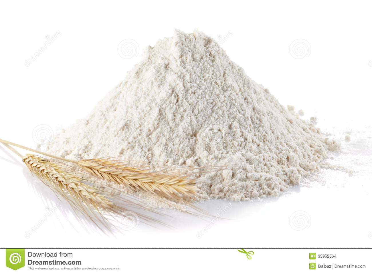 Heap of wheat flour and wheat ears on isolated white background.