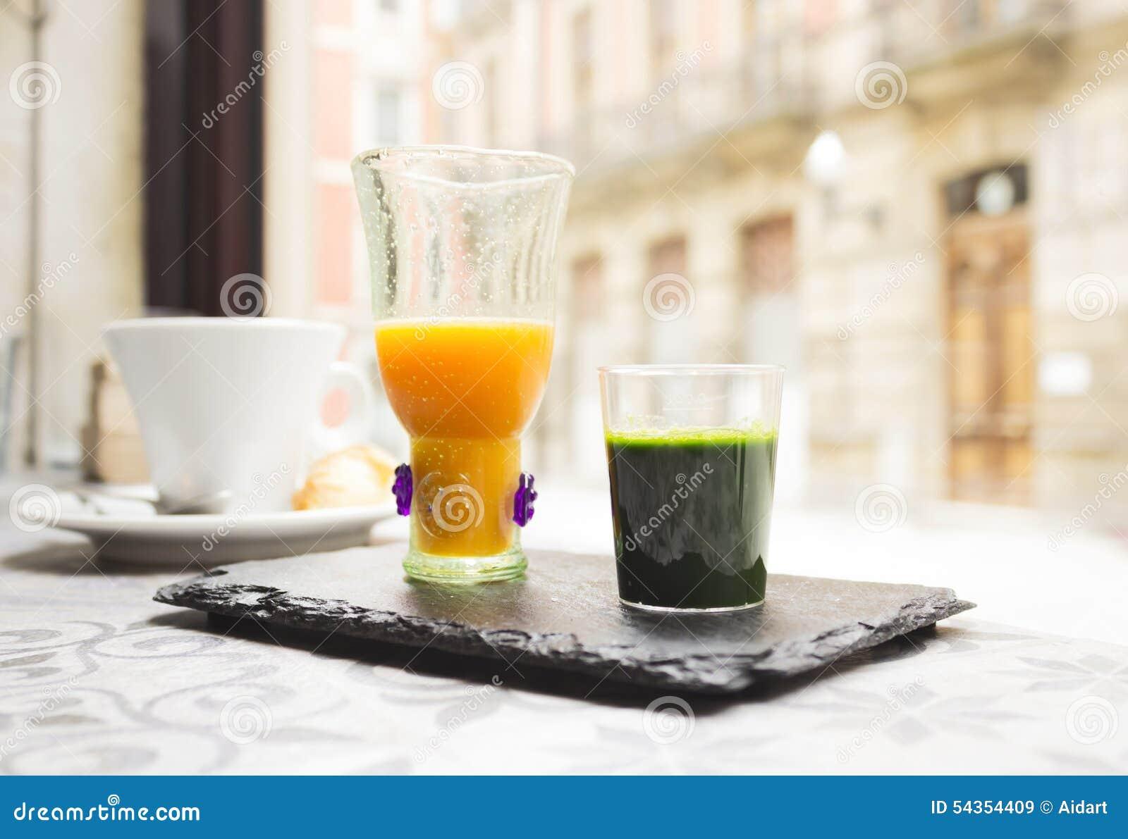 Wheat grass short and orange juice