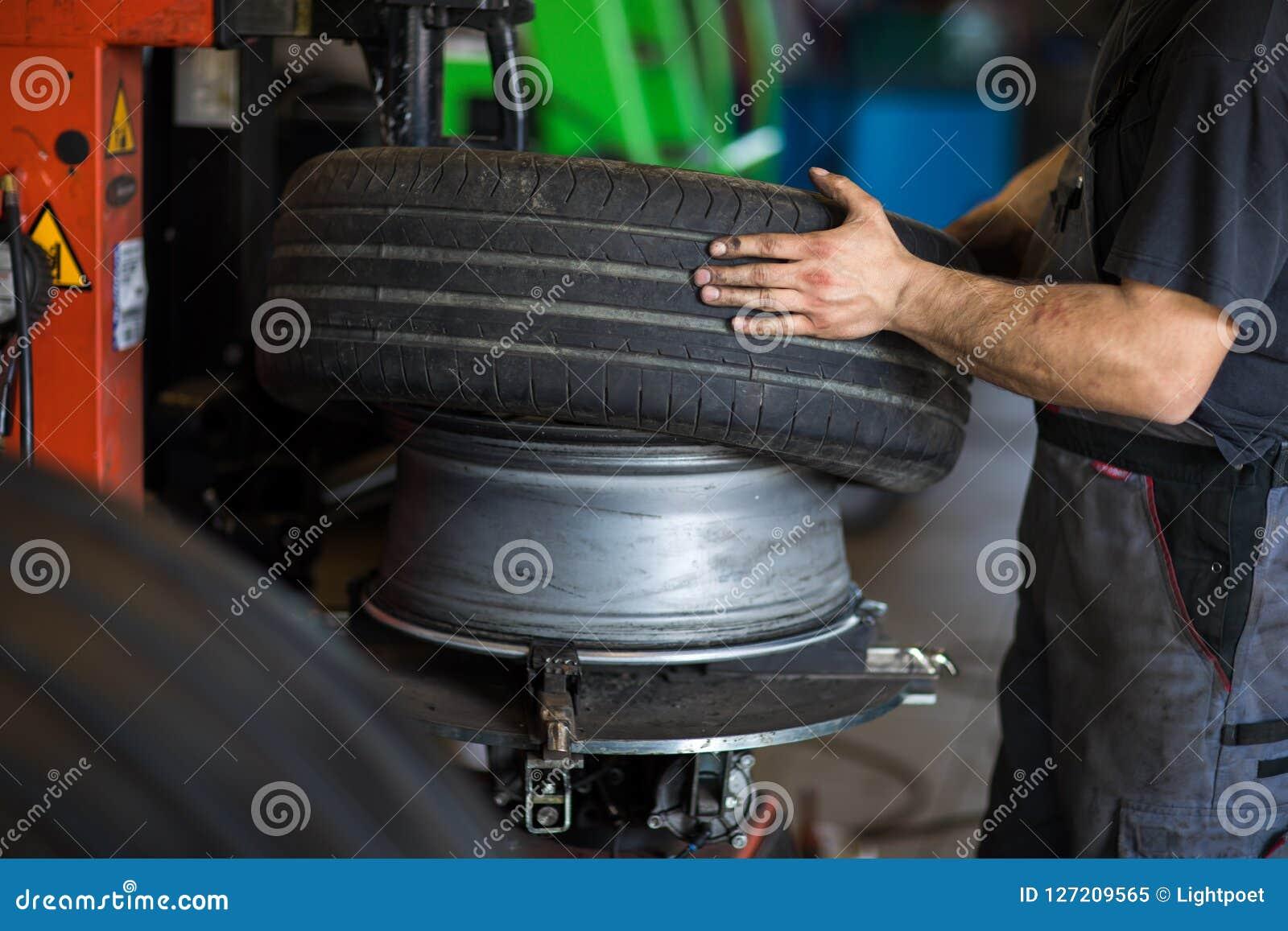 Wheel balancing or repair and change car tire at auto service