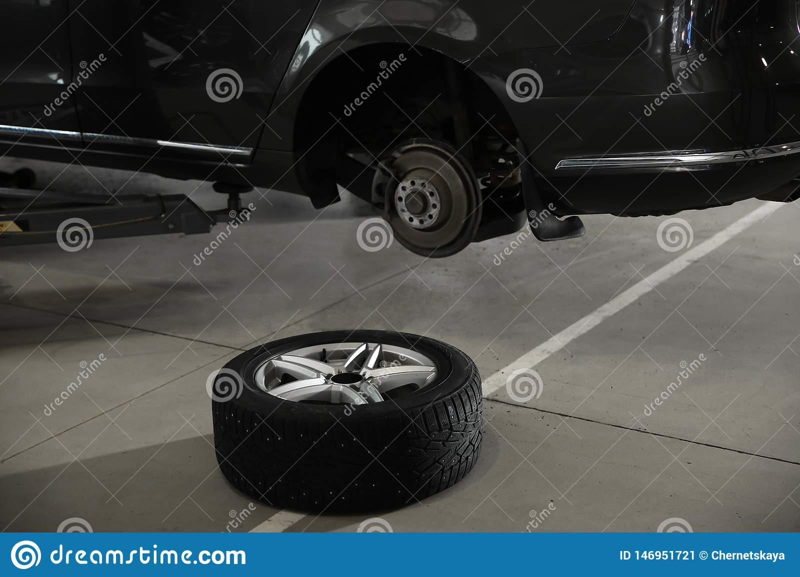 Auto Repair Nearby >> Wheel Near Lifted Car At Automobile Repair Shop Stock Image